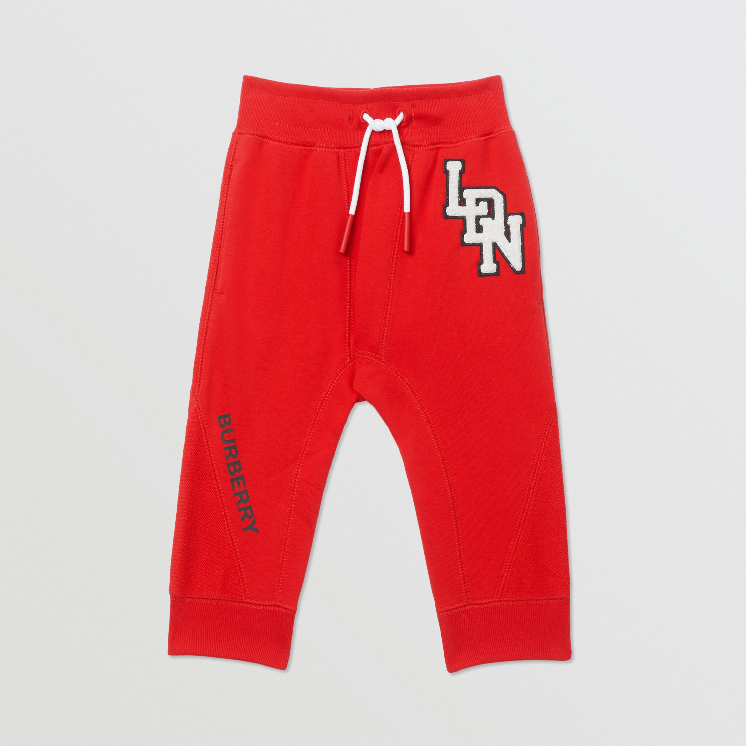 Logo Graphic Cotton Trackpants in Bright Red - Children | Burberry - 1