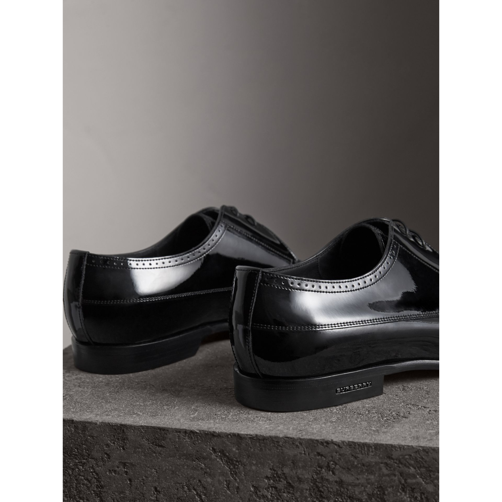 Broguing Detail Polished Leather Derby Shoes in Black - Men | Burberry Singapore - gallery image 3
