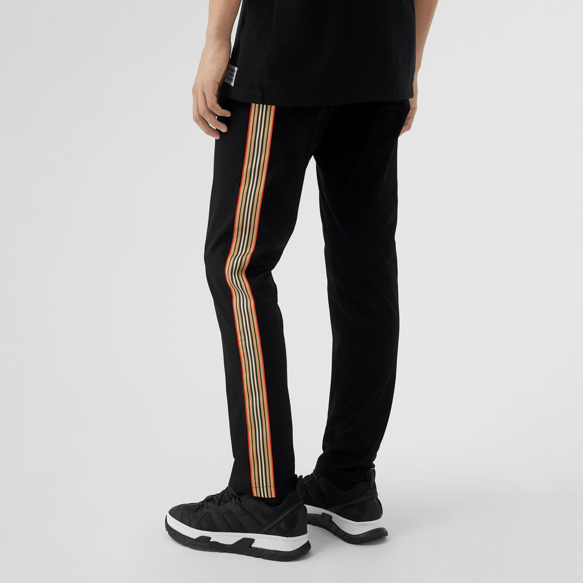 Slim Fit Icon Stripe Detail Cotton Chinos in Black - Men | Burberry - gallery image 2