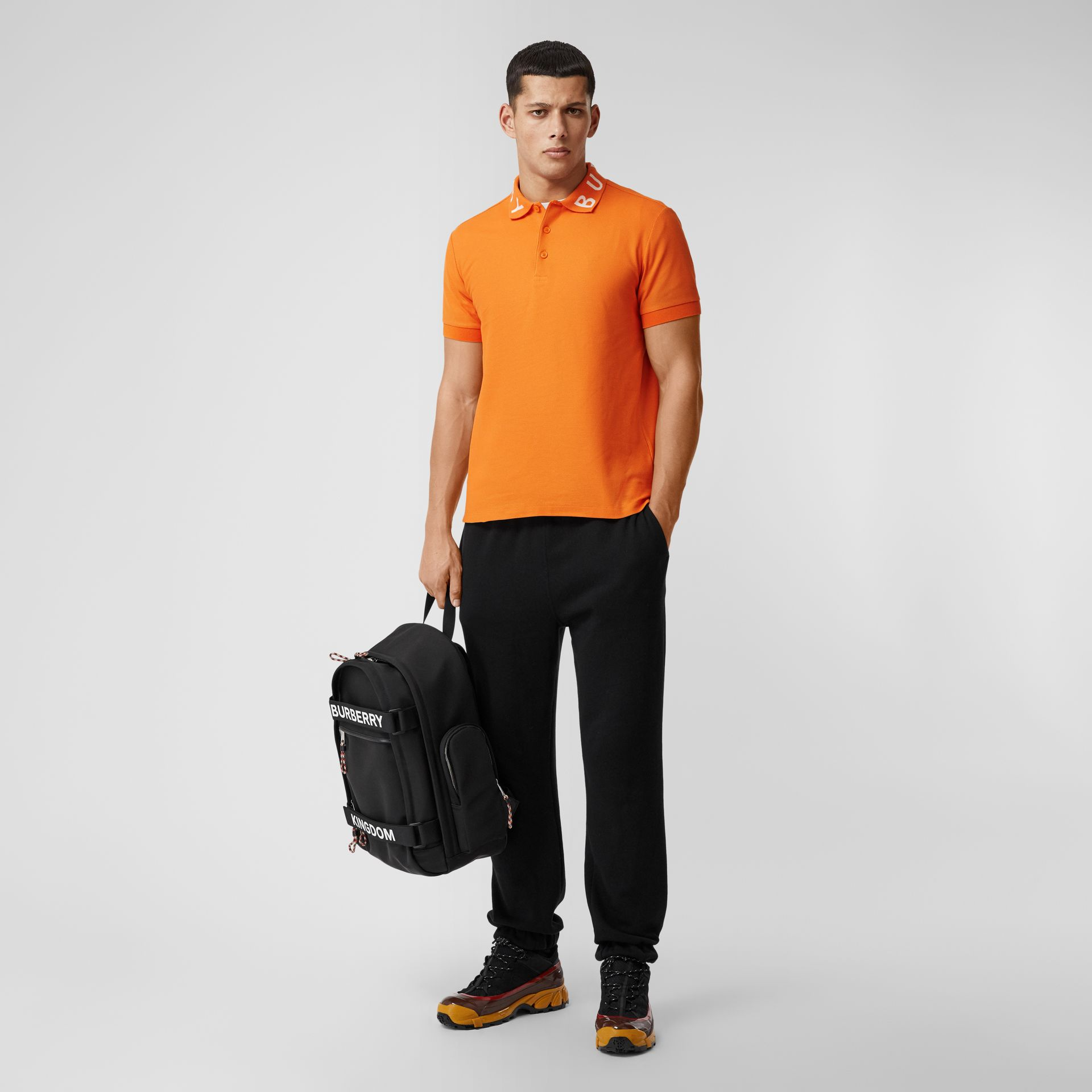 Polo in cotone piqué con logo a intarsio (Arancione Intenso) - Uomo | Burberry - immagine della galleria 0