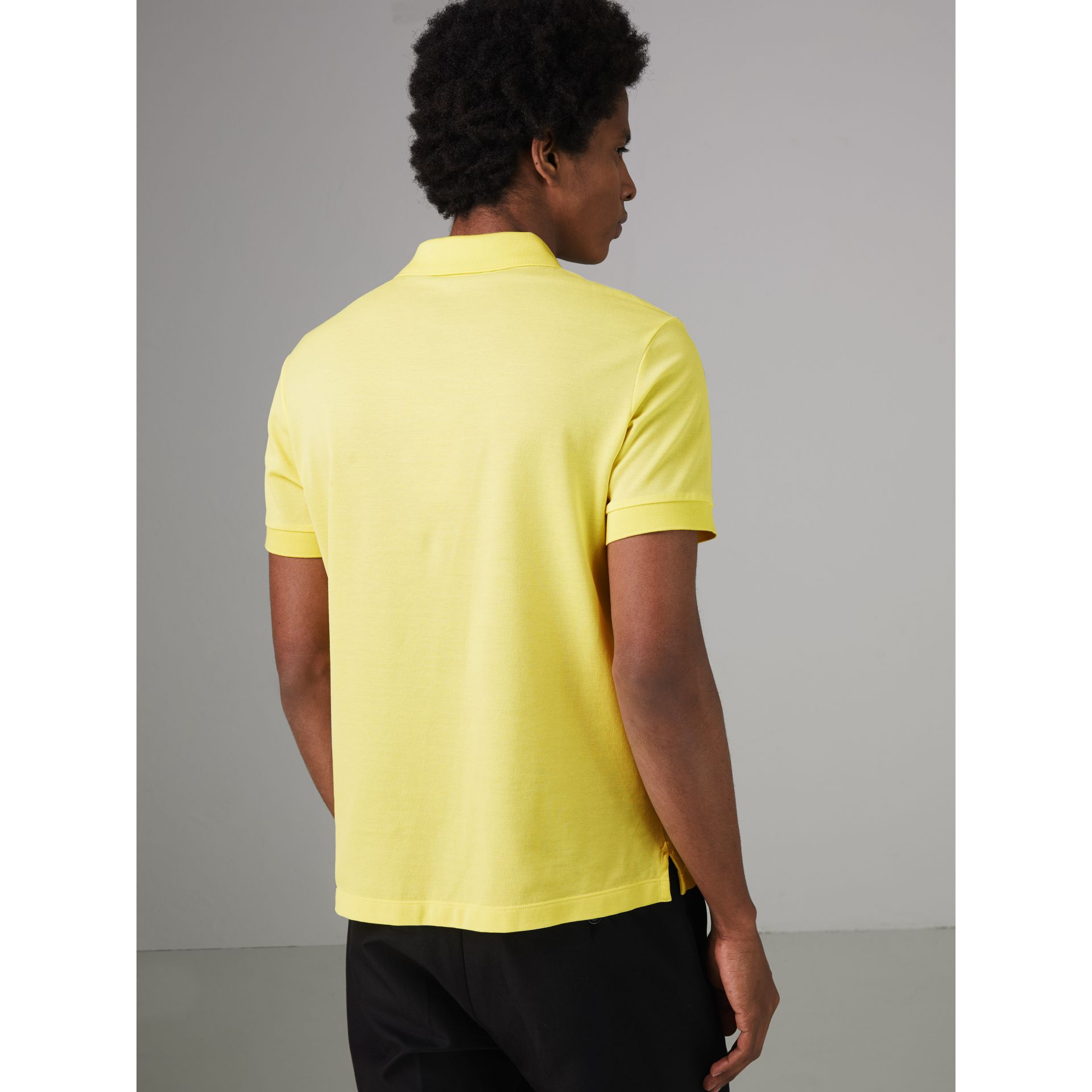 Painted Button Cotton Piqué Polo Shirt in Vibrant Lemon - Men | Burberry - gallery image 2