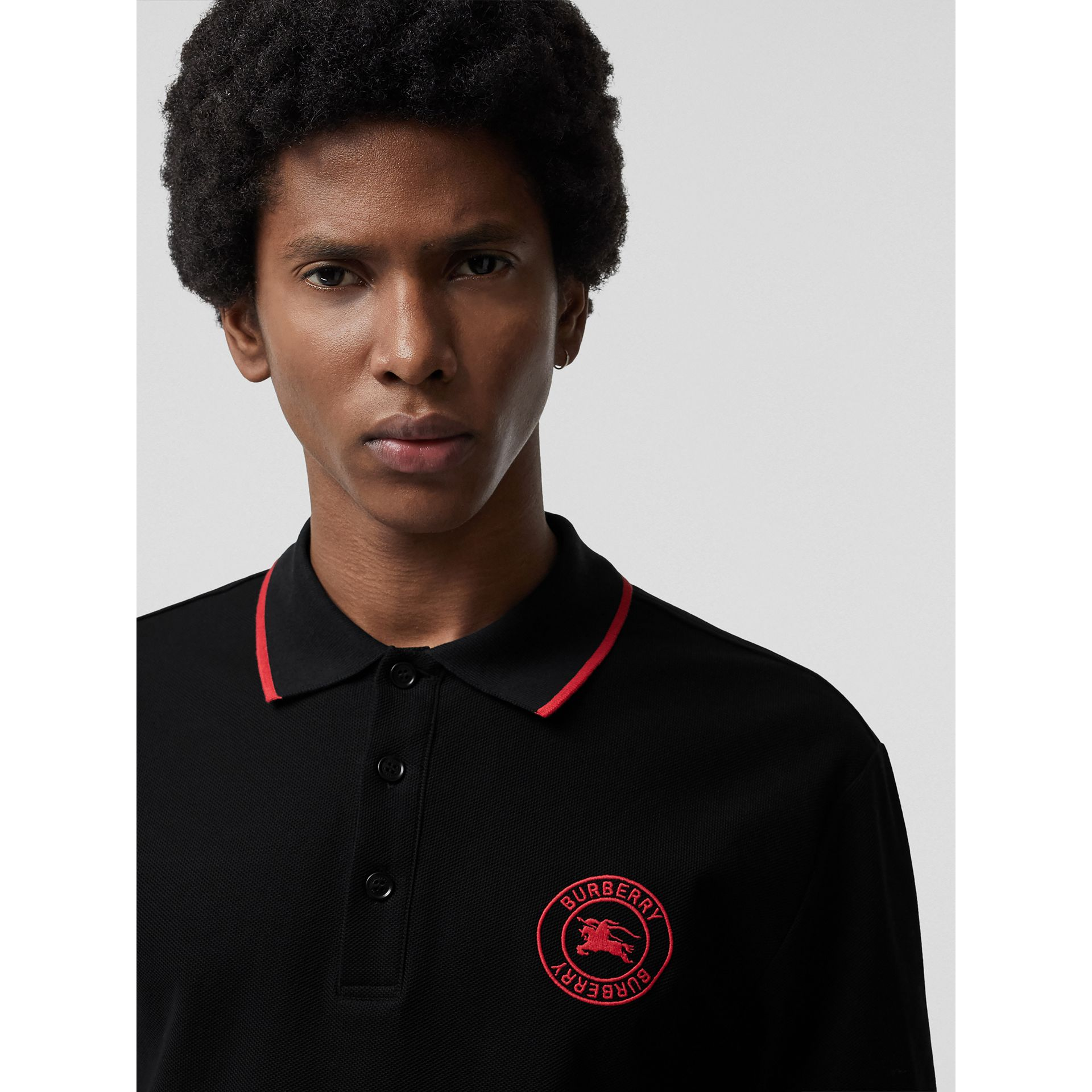 Embroidered Logo Cotton Piqué Polo Shirt in Black - Men | Burberry - gallery image 1