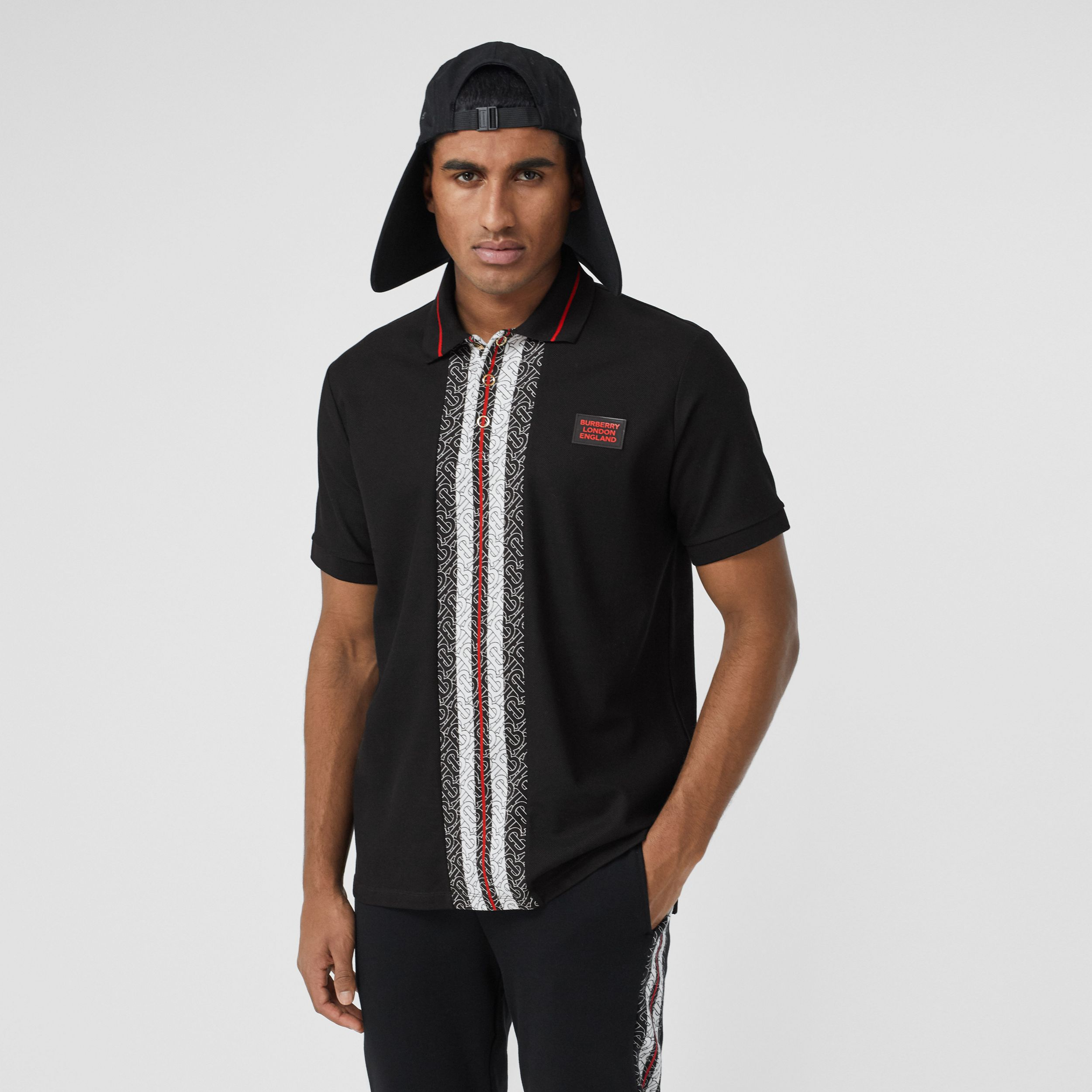 Monogram Stripe Print Cotton Piqué Polo Shirt in Black - Men | Burberry - 1