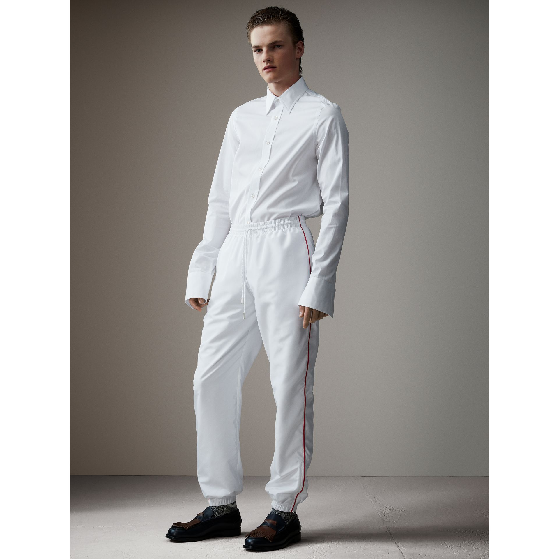 Poplin Track Pants with Contrast Piping in White - Men | Burberry - gallery image 1
