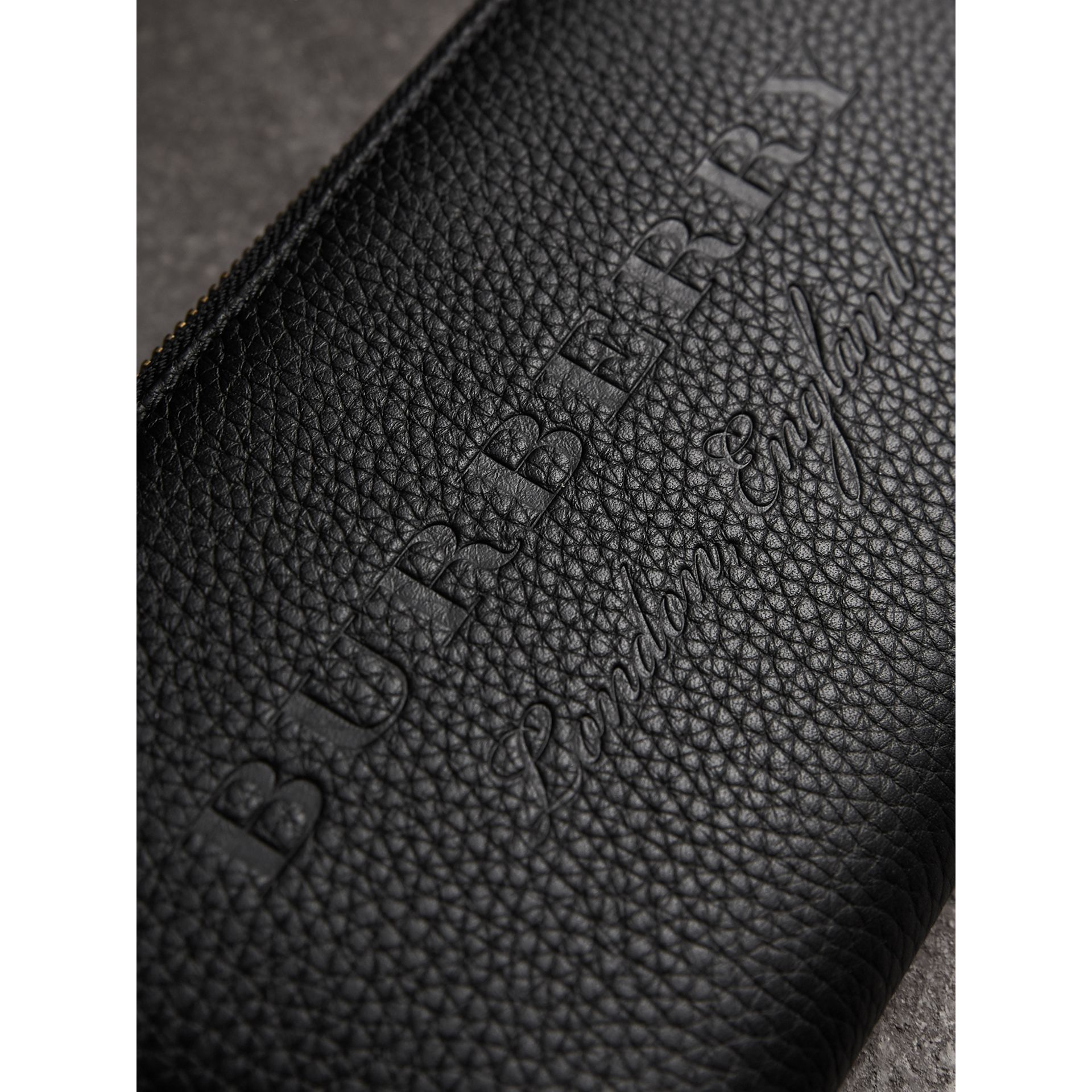 Embossed Grainy Leather Ziparound Wallet in Black - Men | Burberry United Kingdom - gallery image 1