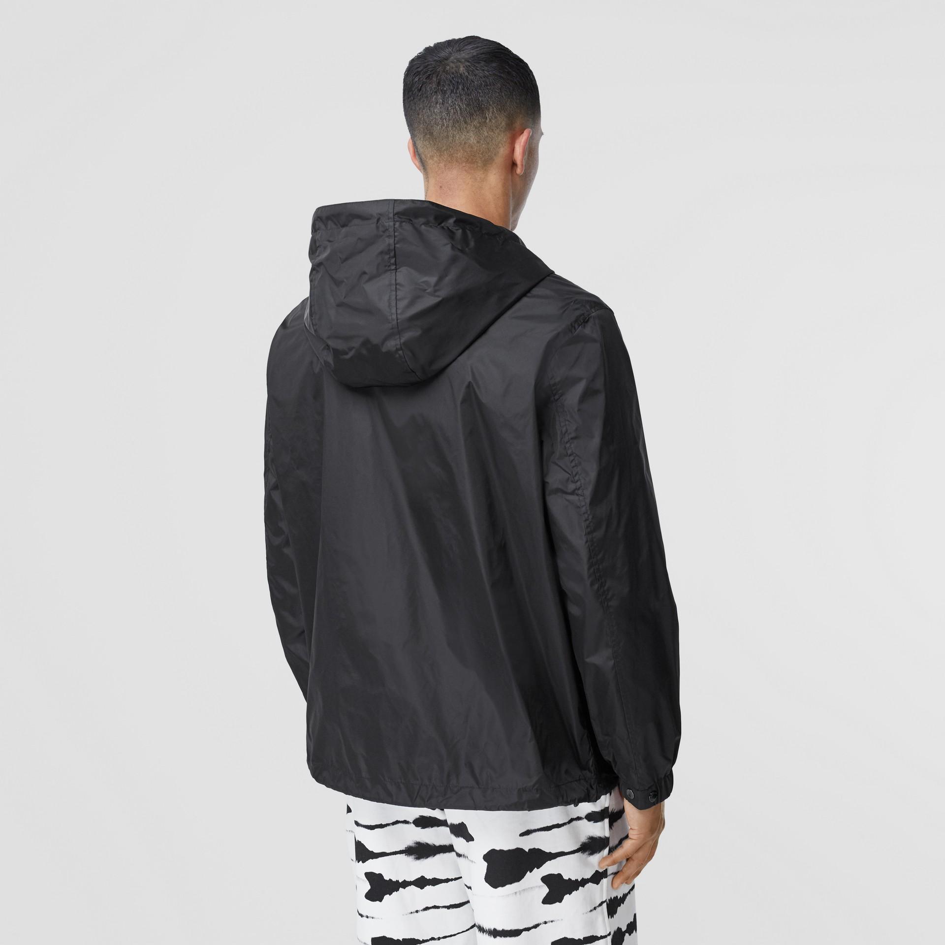 Logo Appliqué ECONYL® Lightweight Hooded Jacket in Black - Men | Burberry - gallery image 2