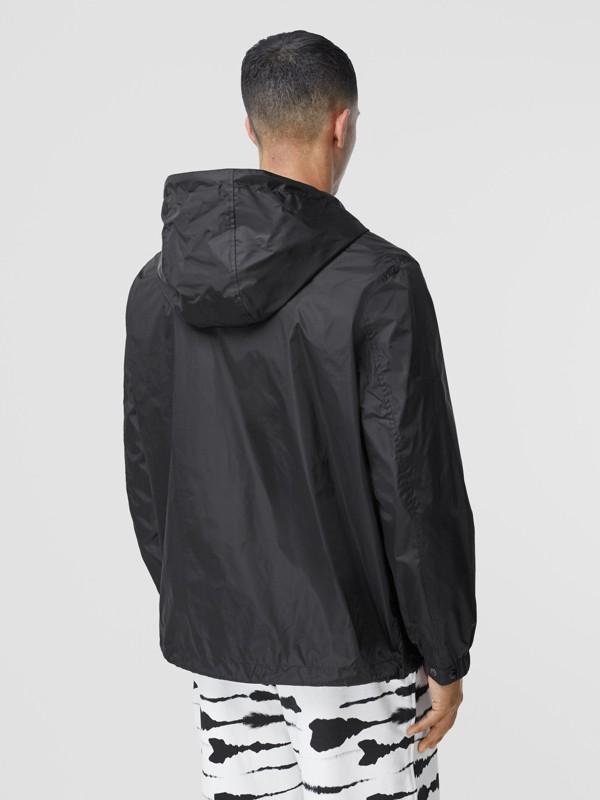 Logo Appliqué ECONYL® Lightweight Hooded Jacket in Black - Men | Burberry - cell image 2