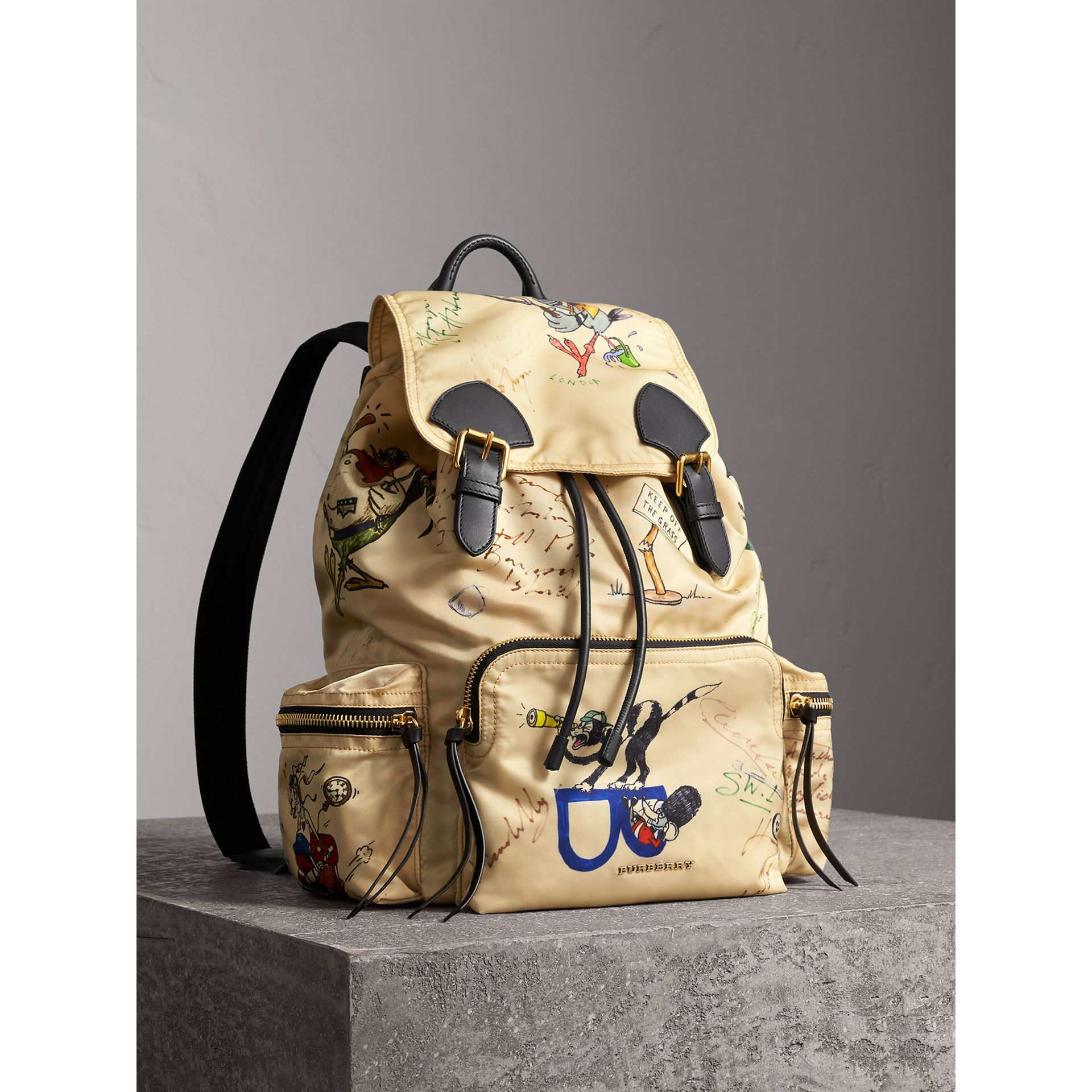 The Large Rucksack in Sketch Print Nylon in Honey | Burberry Singapore - gallery image 1