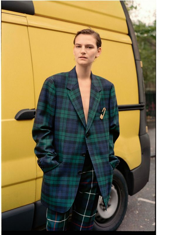 Hirschy wears a Black Watch tartan jacket.