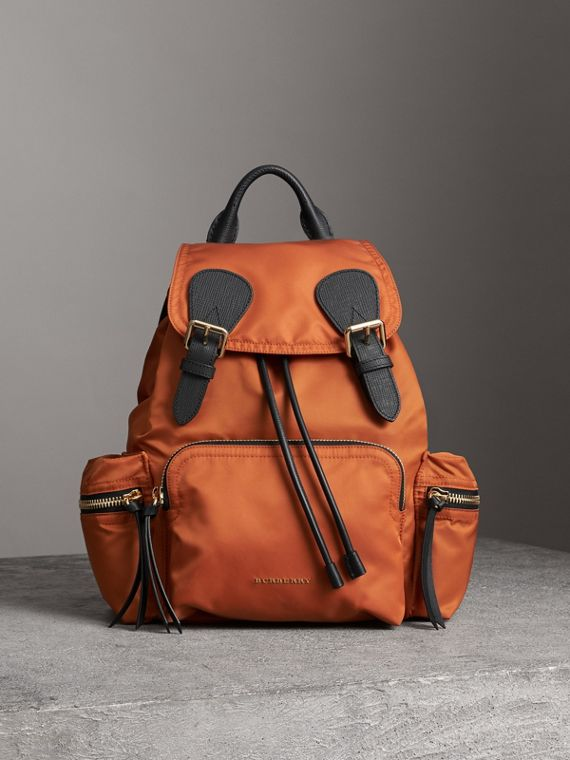 The Medium Rucksack in Technical Nylon and Leather in Clementine