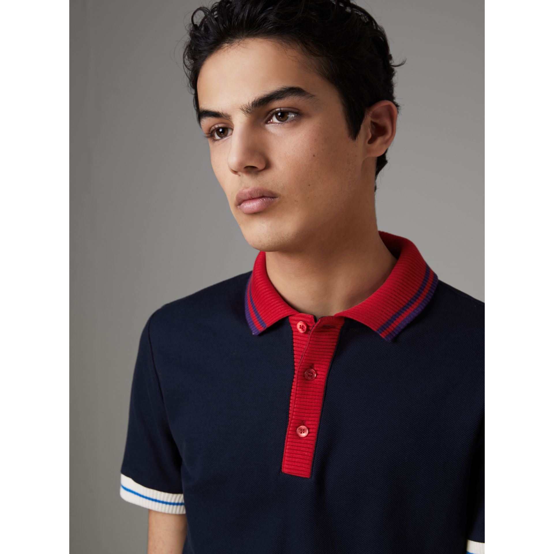 Two-tone Stripe Knitted Detail Cotton Polo Shirt in Navy - Men | Burberry - gallery image 1