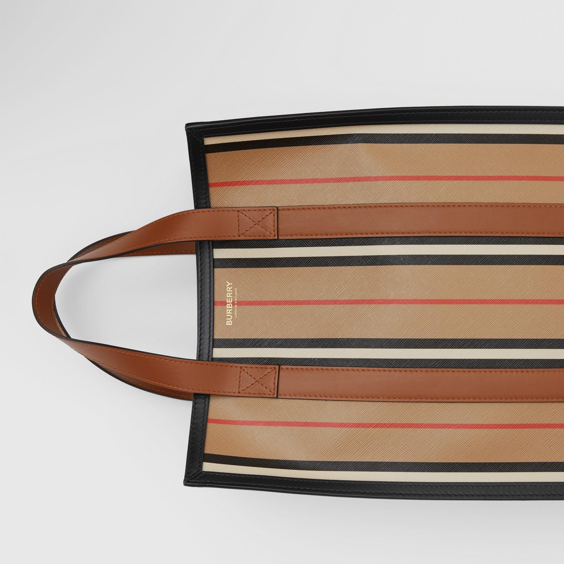 Small Icon Stripe E-canvas Portrait Tote Bag in Archive Beige - Women | Burberry United Kingdom - gallery image 1