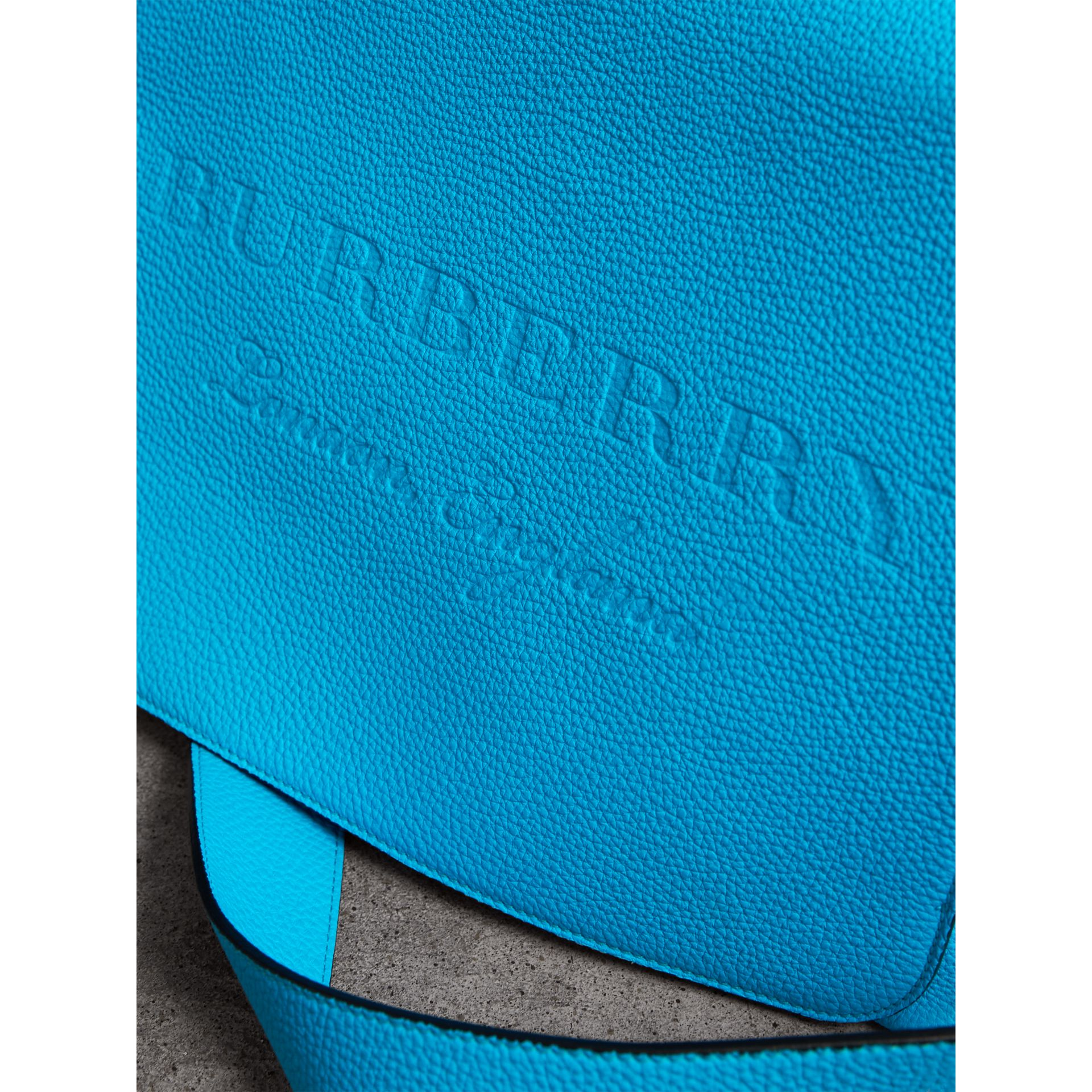 Large Embossed Leather Messenger Bag in Neon Blue | Burberry - gallery image 1