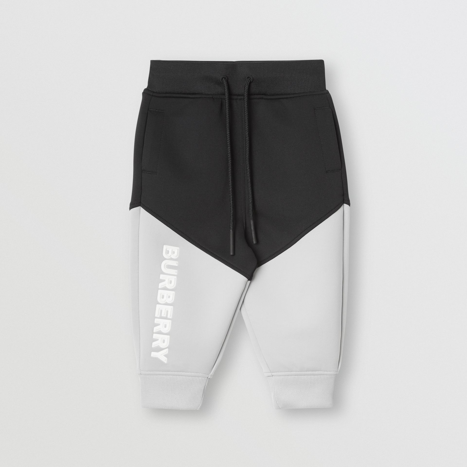 Logo Print Two-tone Stretch Jersey Trackpants in Black - Children | Burberry - gallery image 0