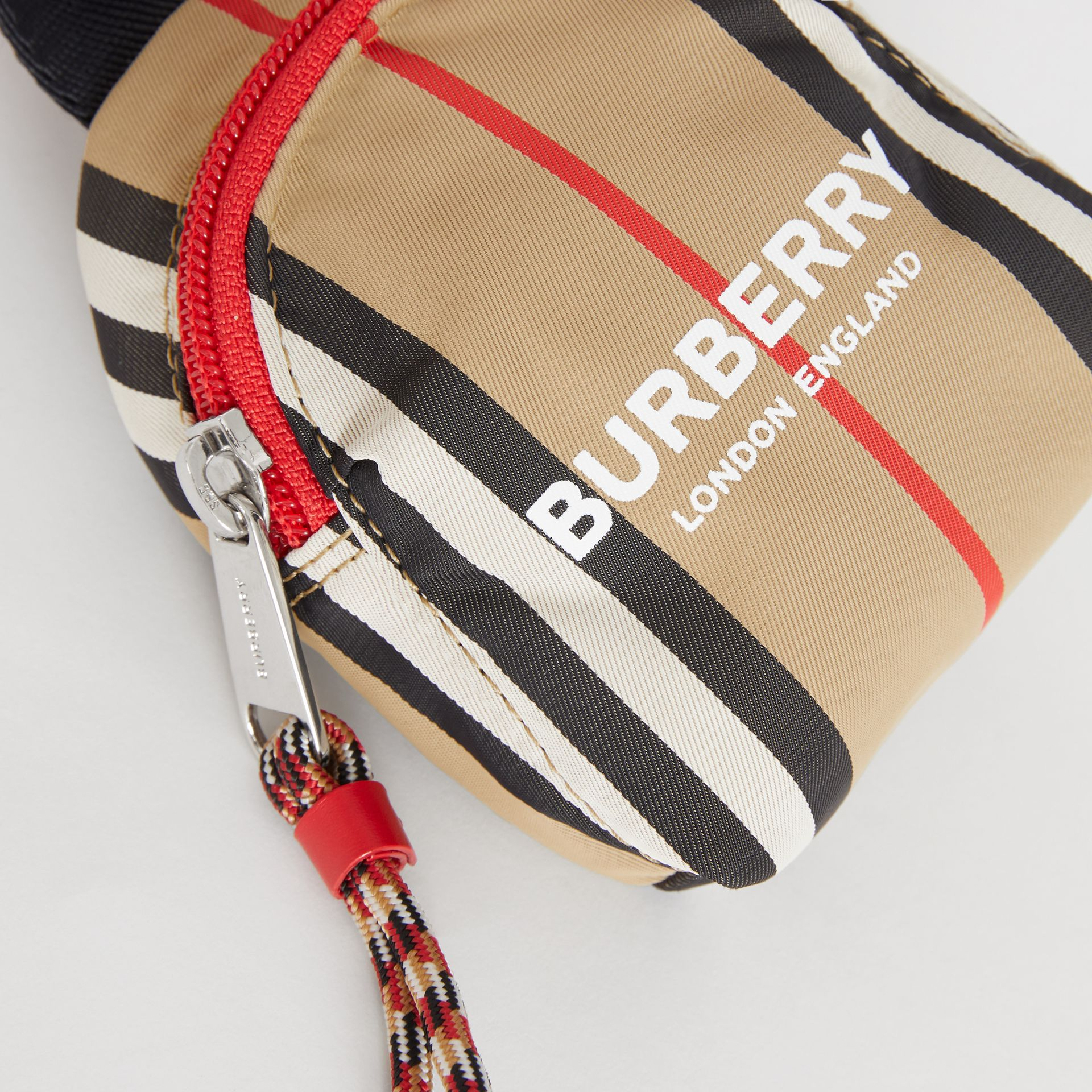 Logo Print Icon Stripe Coin Case in Archive Beige - Children | Burberry Australia - gallery image 1