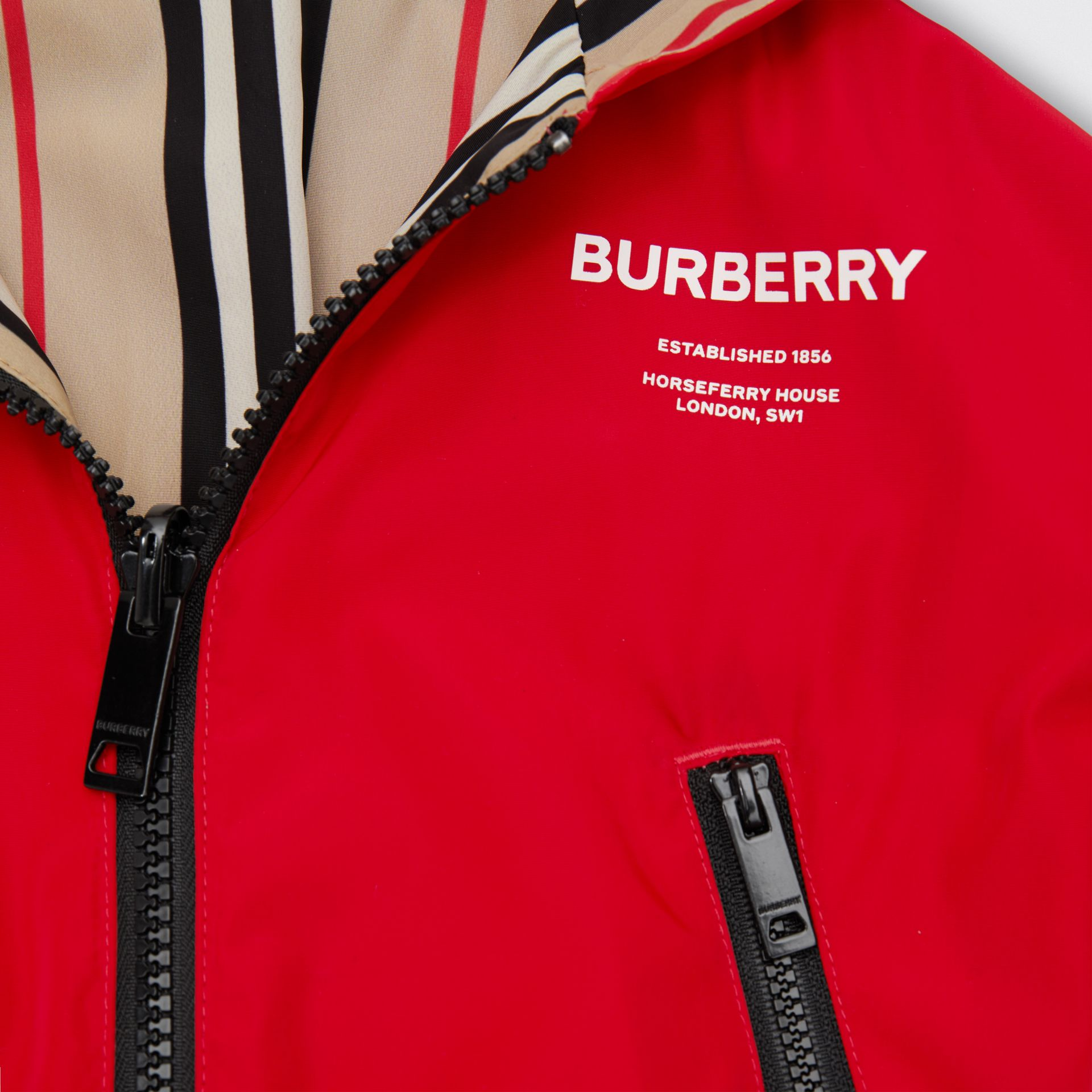 Reversible Icon Stripe Lightweight Hooded Jacket in Bright Red - Children | Burberry - gallery image 1