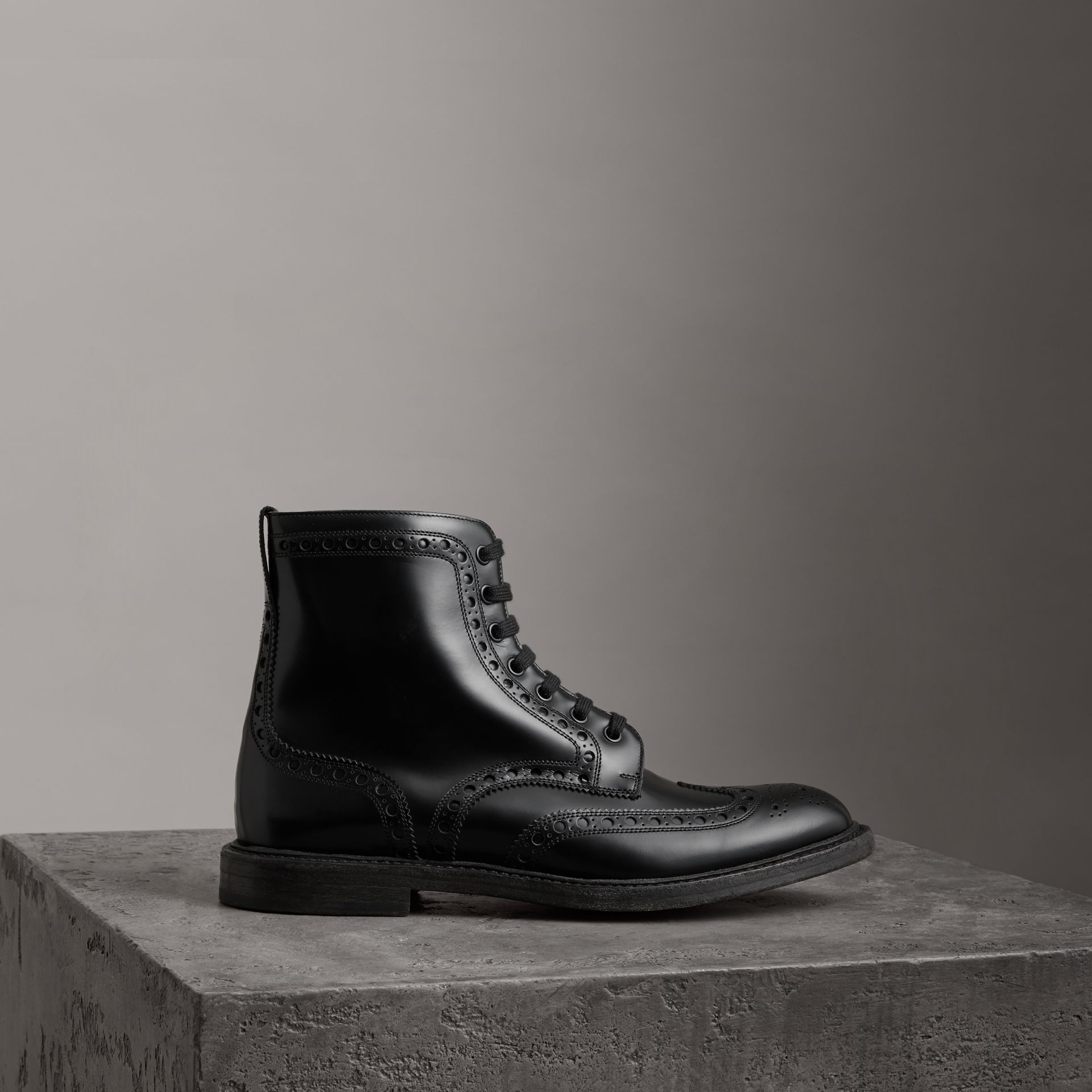 Brogue Detail Polished Leather Boots in Black - Men | Burberry - gallery image 0
