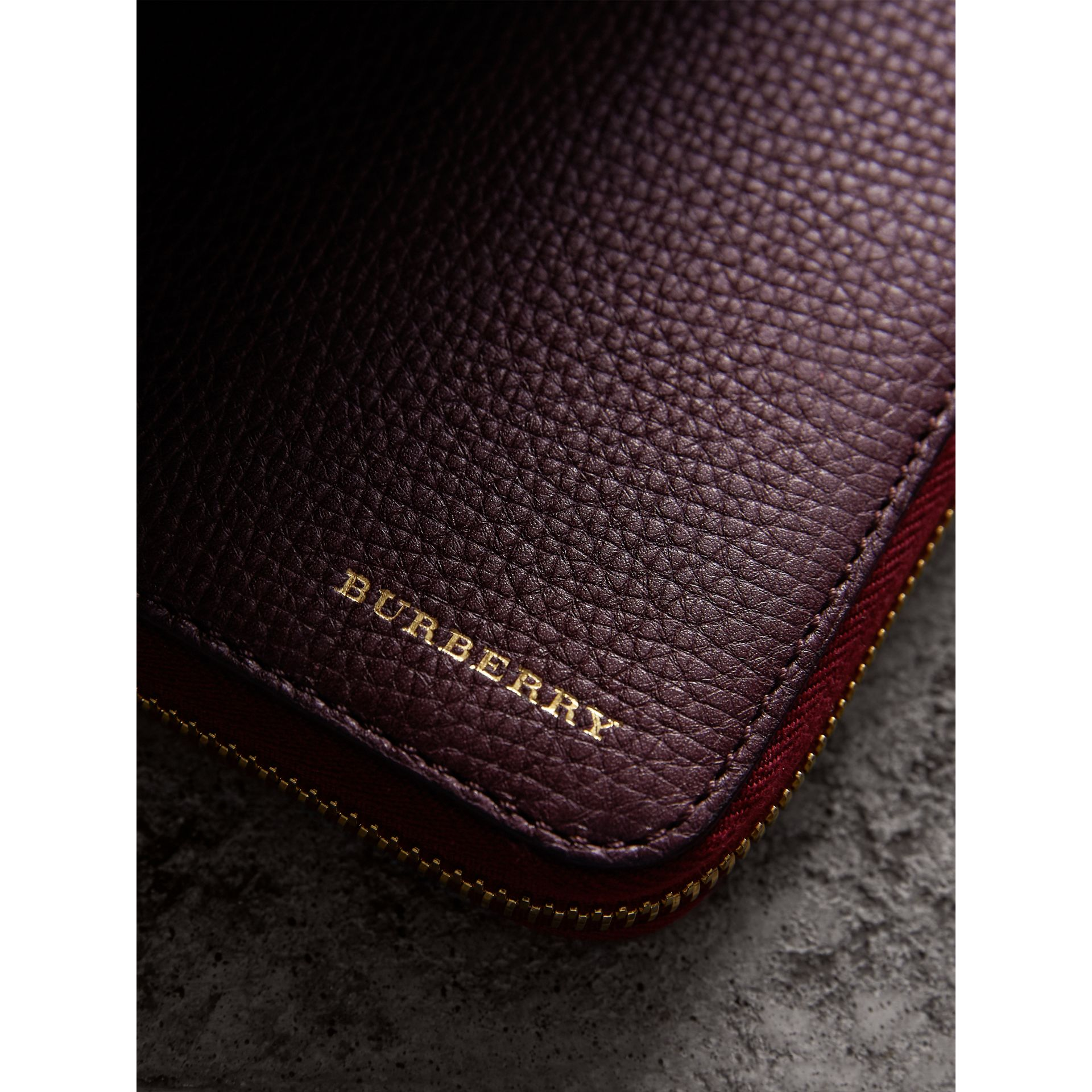 House Check and Grainy Leather Ziparound Wallet in Wine | Burberry United Kingdom - gallery image 1