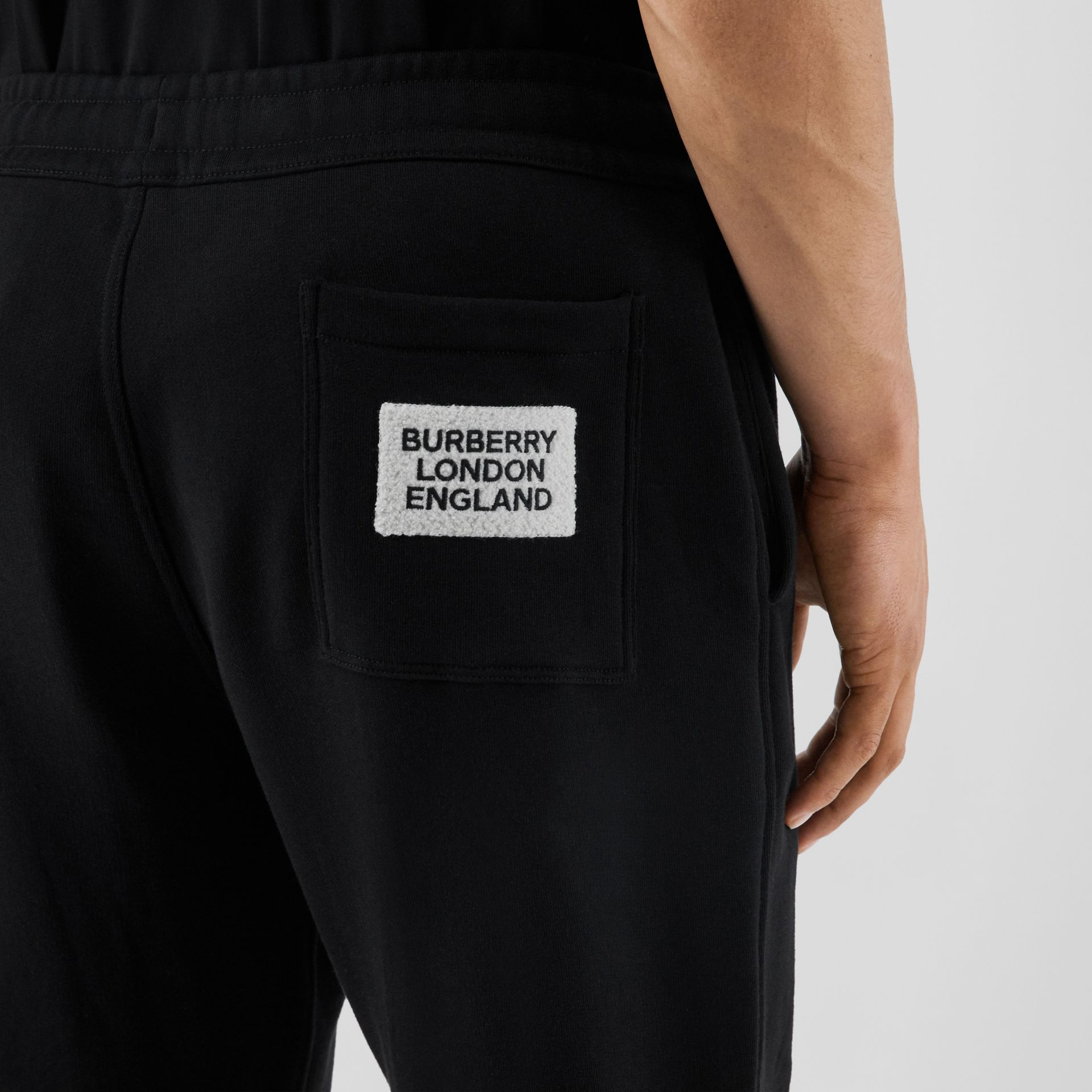 Logo Appliqué Cotton Trackpants in Black - Men | Burberry - gallery image 1