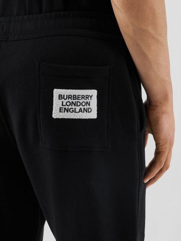 Logo Appliqué Cotton Trackpants in Black - Men | Burberry - cell image 1