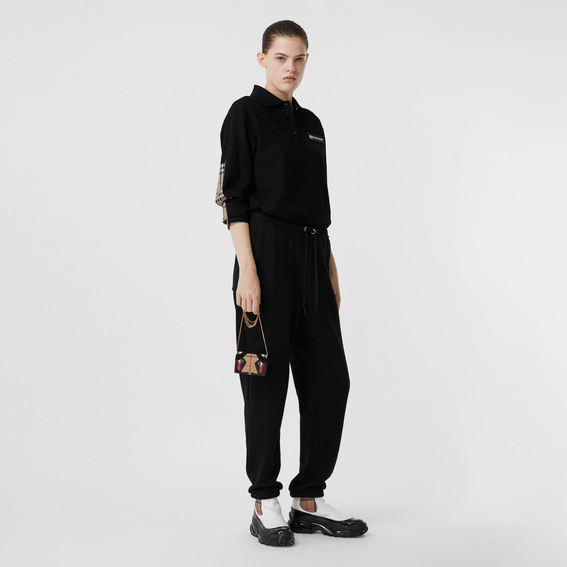 Long-sleeve Vintage Check Panel Oversized Polo Shirt in Black - Women | Burberry United Kingdom - gallery image 0