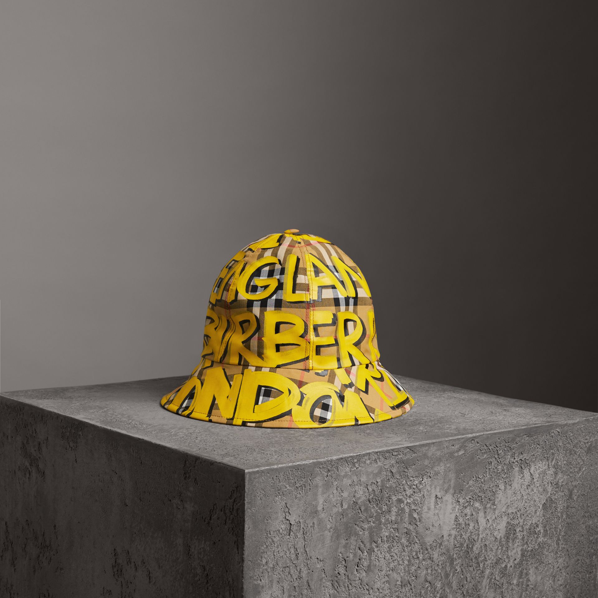 Graffiti Print Vintage Check Bucket Hat in Bright Yellow/antique Yellow | Burberry United Kingdom - gallery image 0