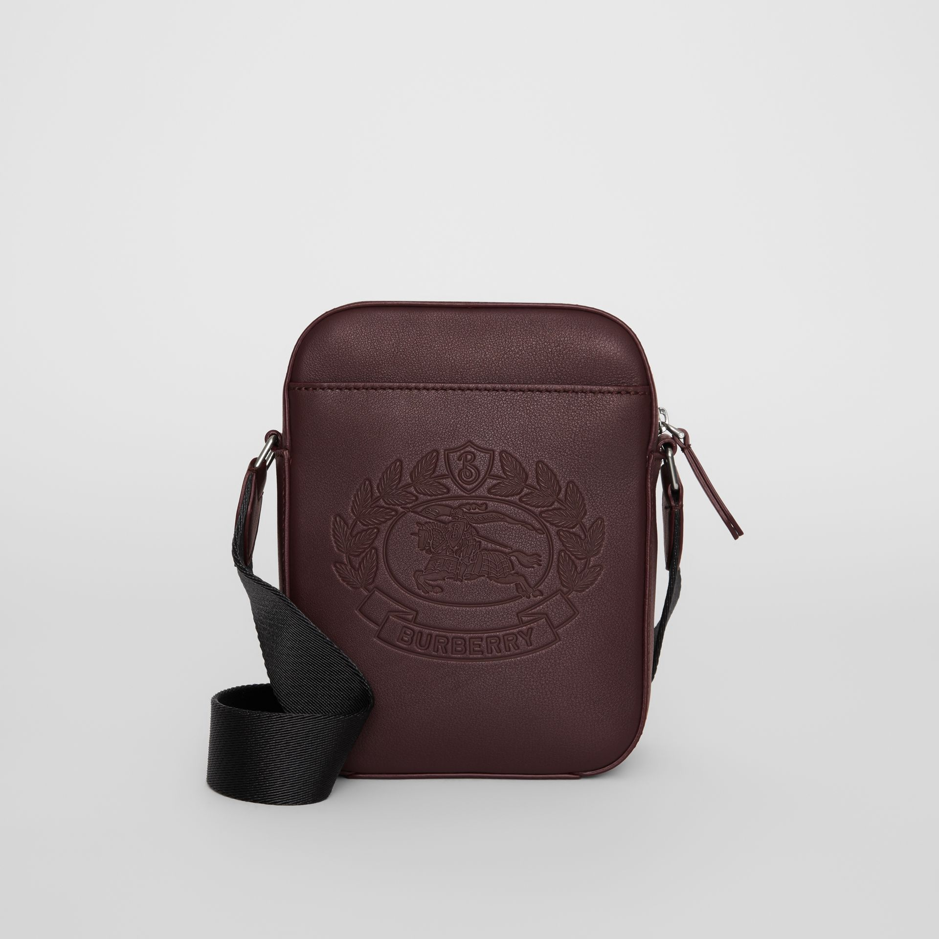 Small Embossed Crest Leather Crossbody Bag in Oxblood - Men | Burberry - gallery image 0