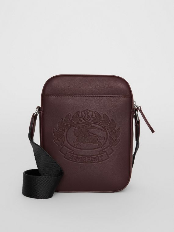 Small Embossed Crest Leather Crossbody Bag in Oxblood