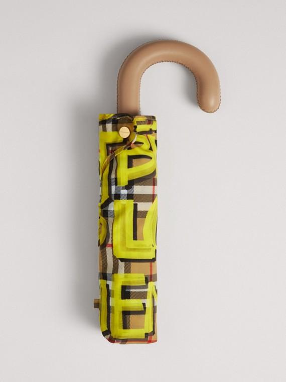 Ombrello pieghevole con motivo Vintage check con graffiti (Giallo)