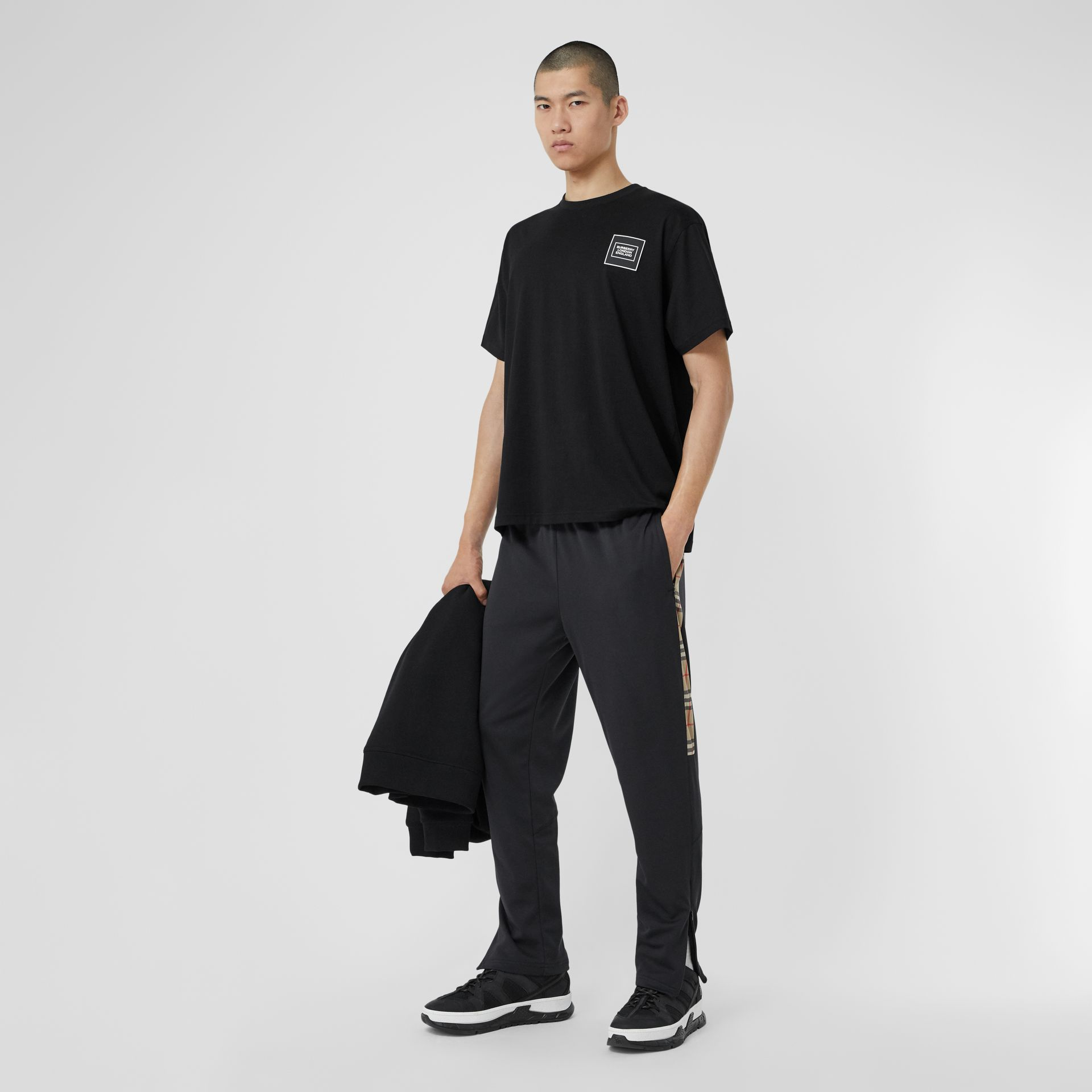 Vintage Check Trim Technical Twill Trackpants in Black - Men   Burberry - gallery image 0