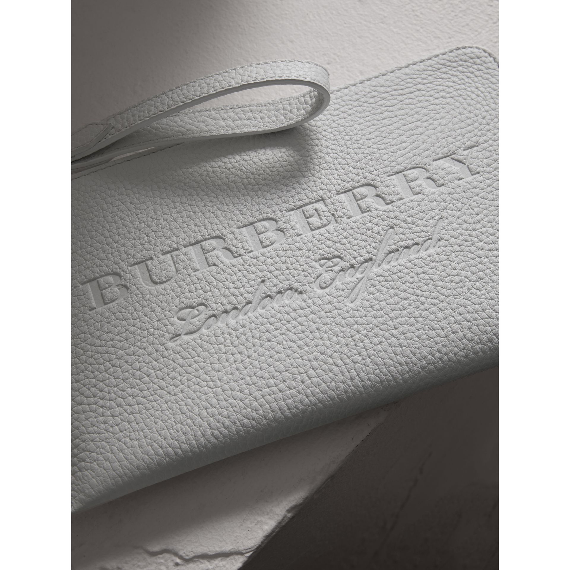 Embossed Leather Travel Wallet in Chalk White | Burberry - gallery image 1