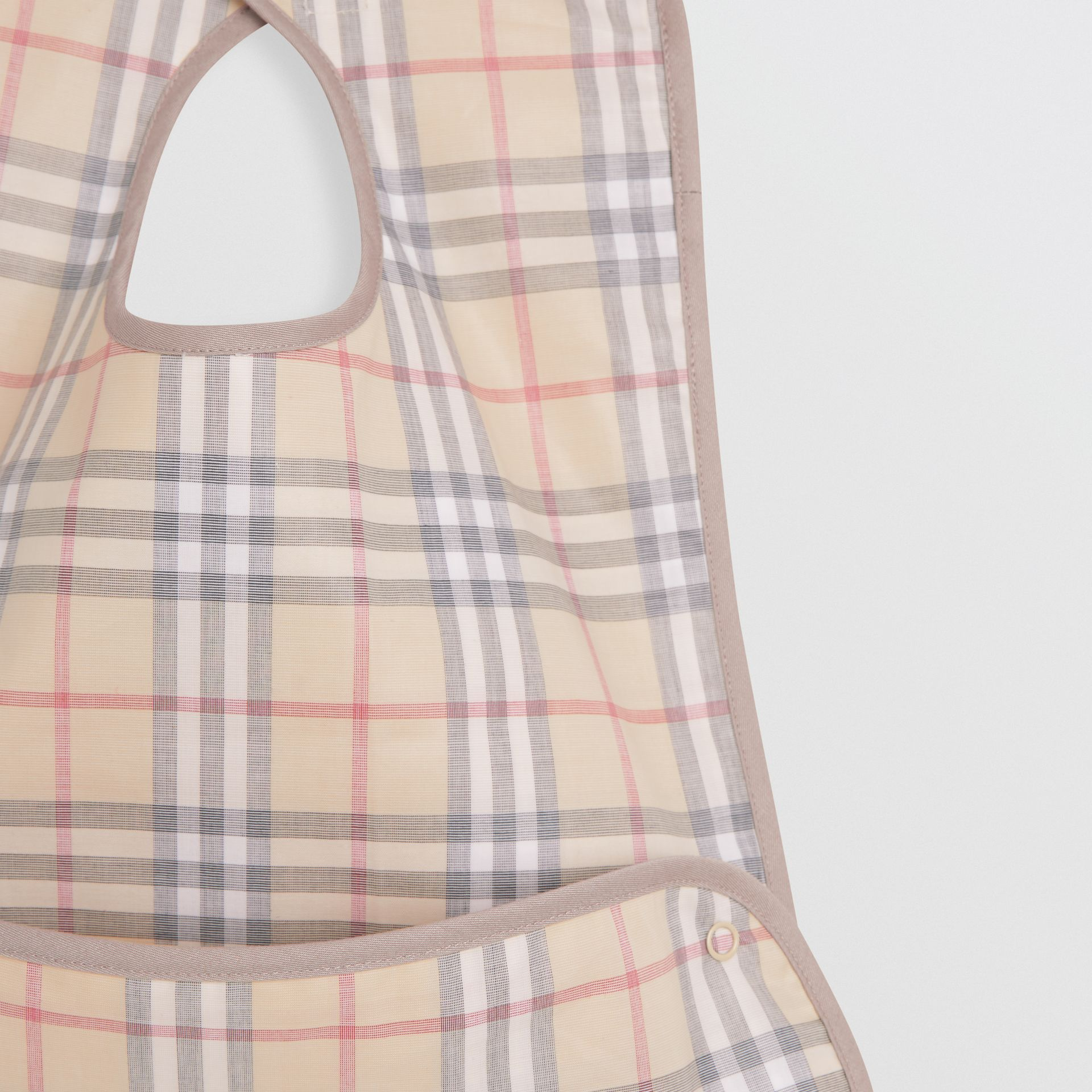 Coated Check Cotton Baby Bib in Pale Stone - Children | Burberry Canada - gallery image 3