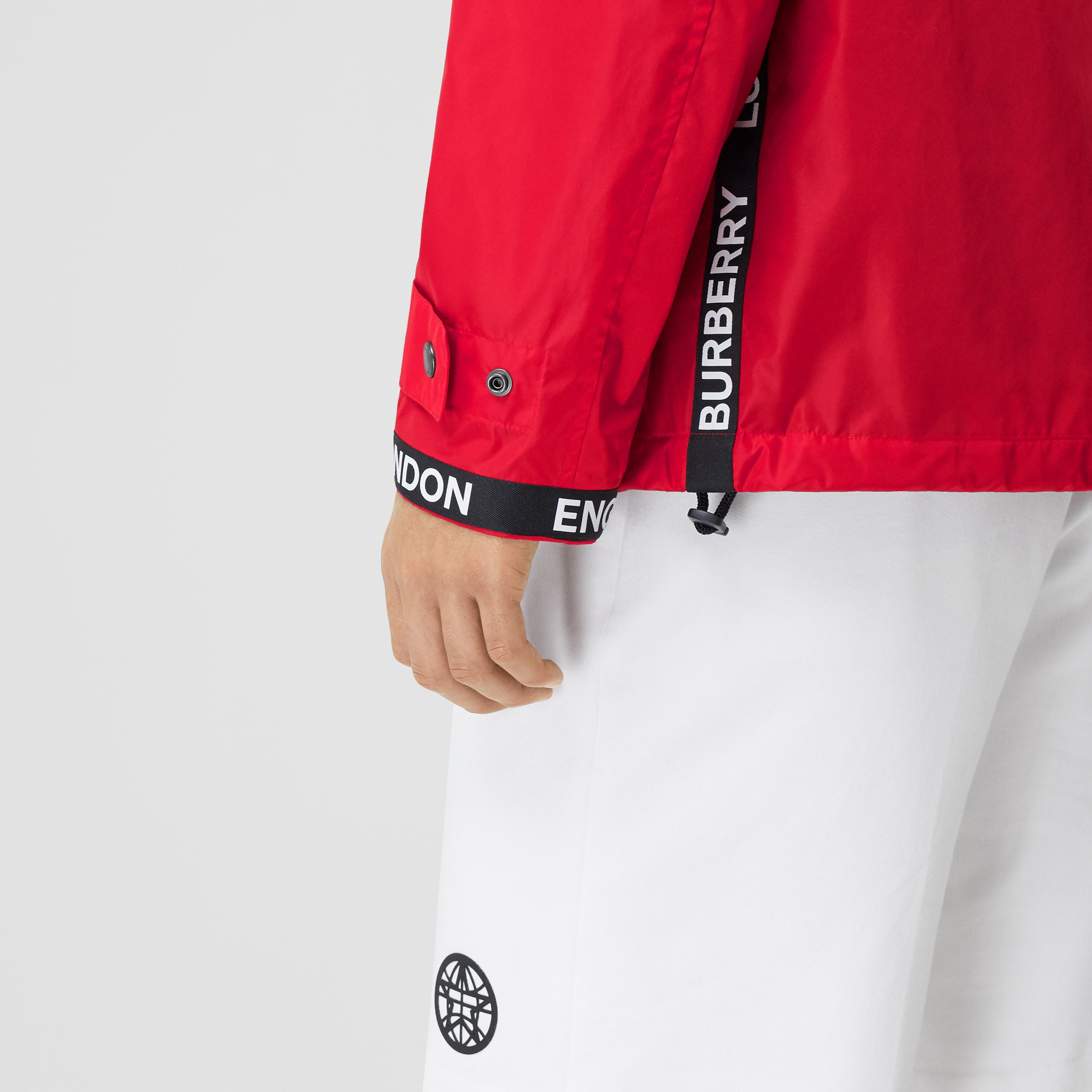 Logo Tape ECONYL® Hooded Jacket in Bright Red - Men | Burberry Canada - 4