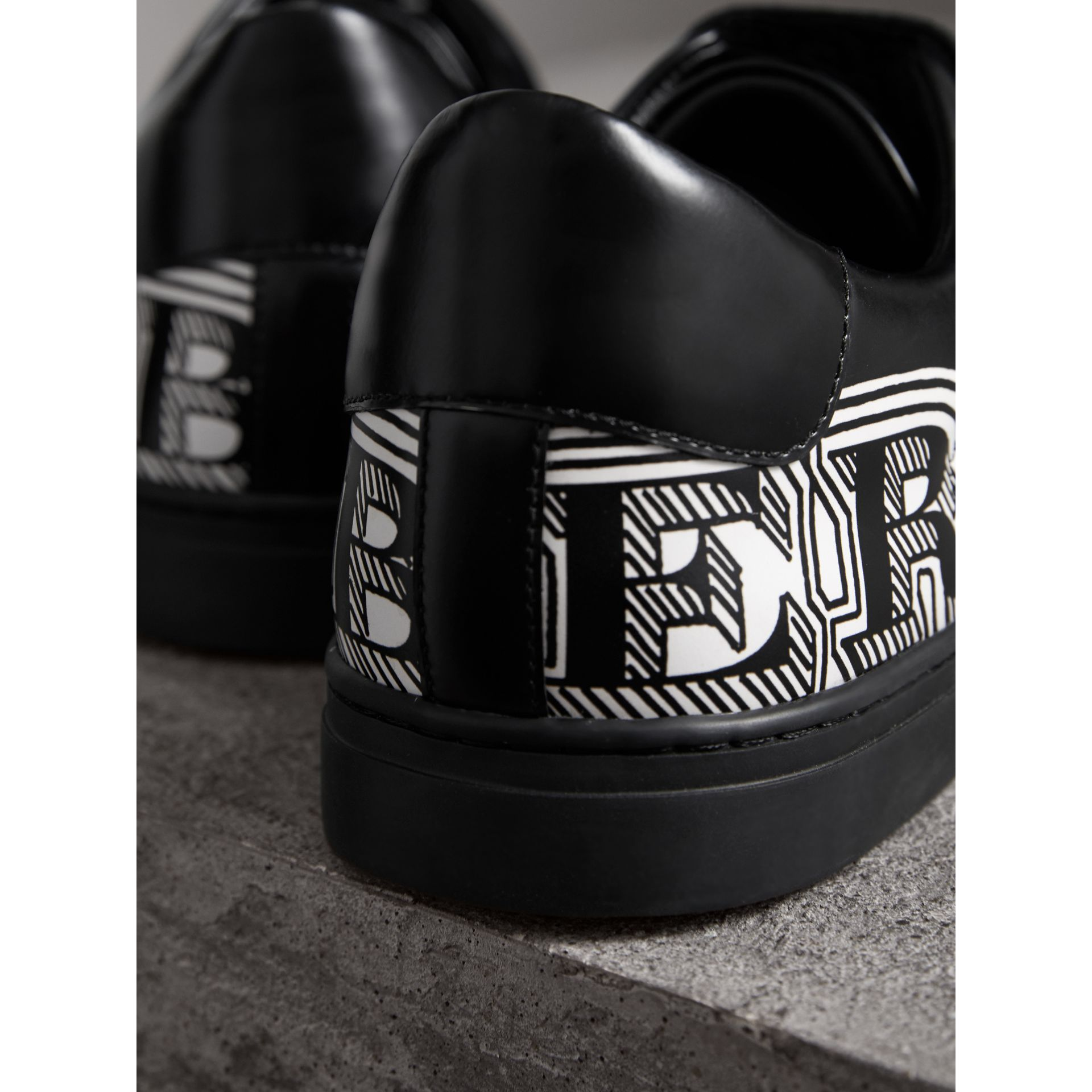 Doodle Print Leather Sneakers in Black - Men | Burberry - gallery image 1