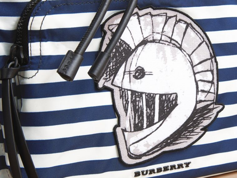 The Large Rucksack in Striped Nylon with Pallas Helmet Motif - cell image 1