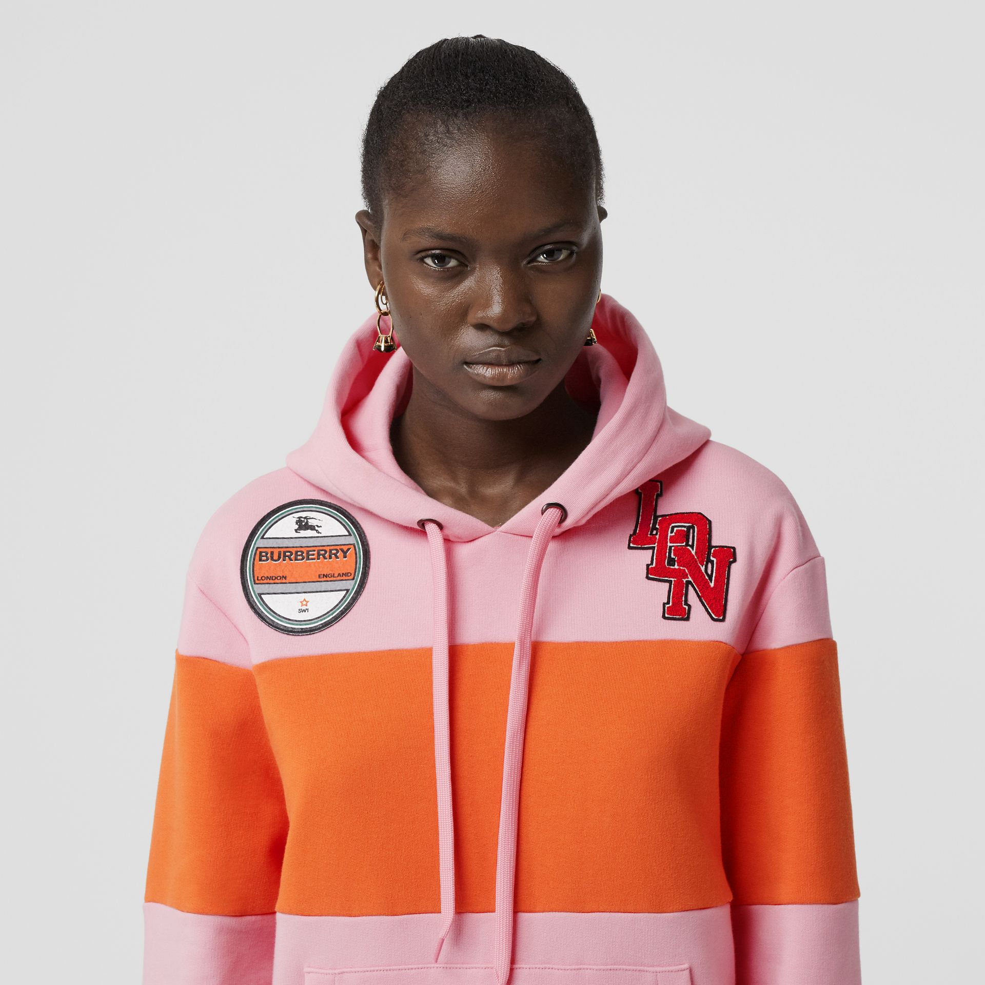 Logo Graphic Panelled Cotton Oversized Hoodie in Candy Pink - Women | Burberry - gallery image 1