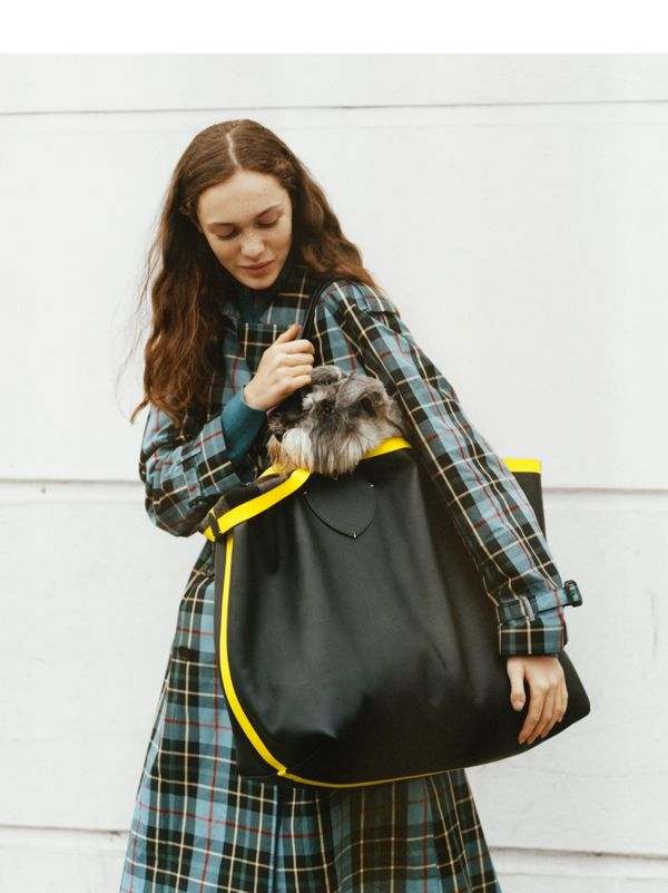 Sophia Roberts with Lola<br>Sophia wears a down-filled puffer jacket and tartan trench.