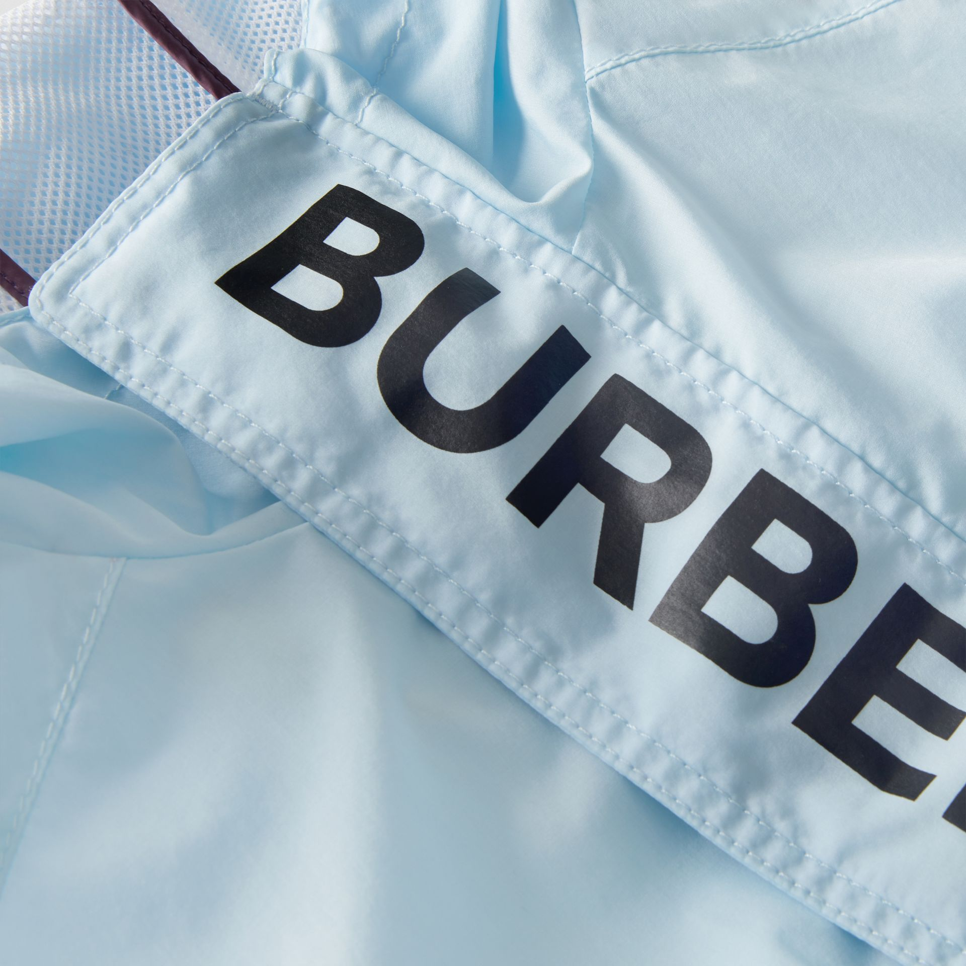 Logo Print Lightweight Hooded Jacket in Light Blue | Burberry - gallery image 1