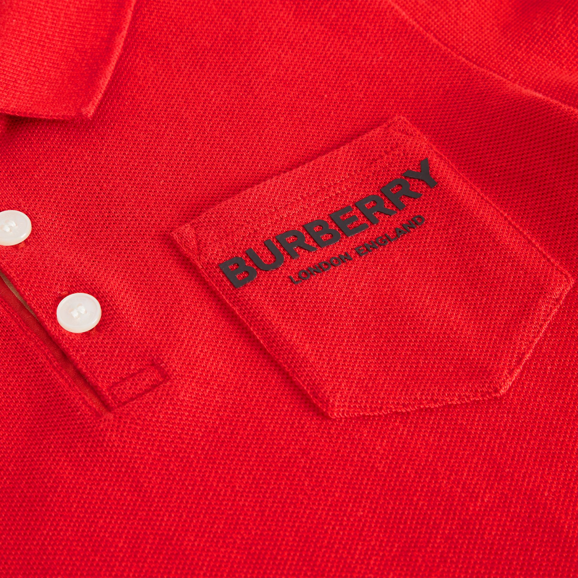 Icon Stripe Placket Cotton Piqué Polo Shirt in Bright Red - Boy | Burberry - gallery image 1