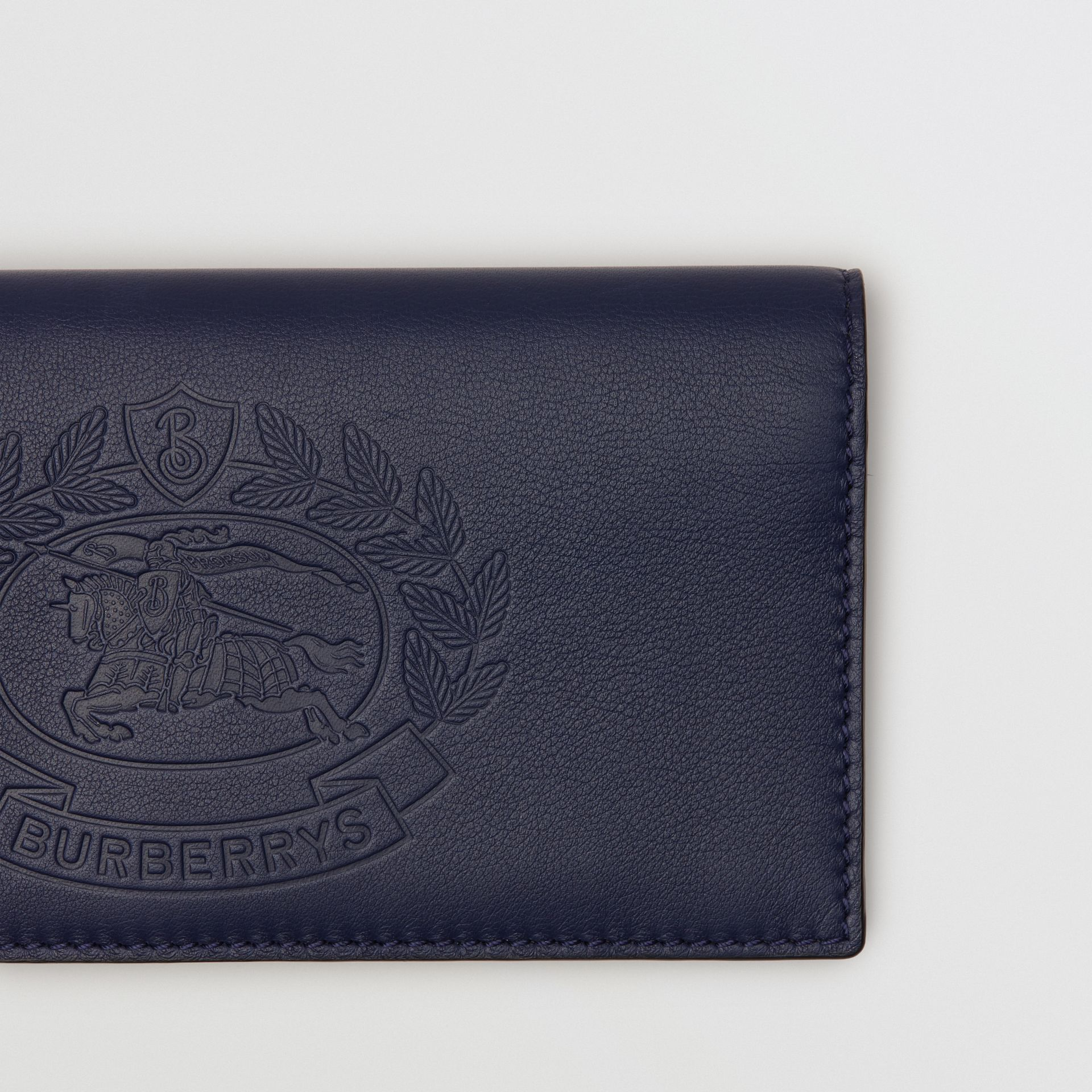 Embossed Crest Leather Continental Wallet in Regency Blue - Men | Burberry - gallery image 1