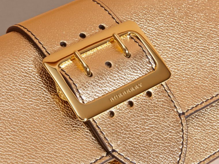 Gold The Medium Buckle Bag in Metallic Leather - cell image 1