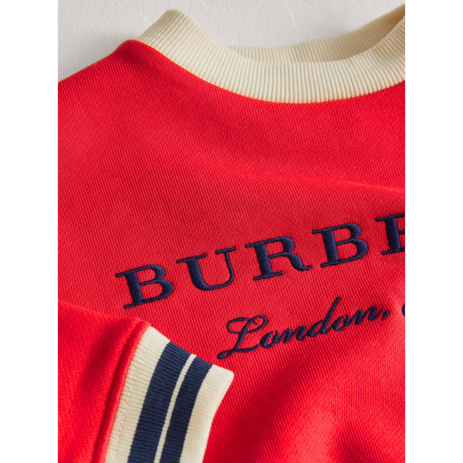 Contrast Stripe Embroidered Cotton Sweatshirt in Bright Orange Red | Burberry - gallery image 1