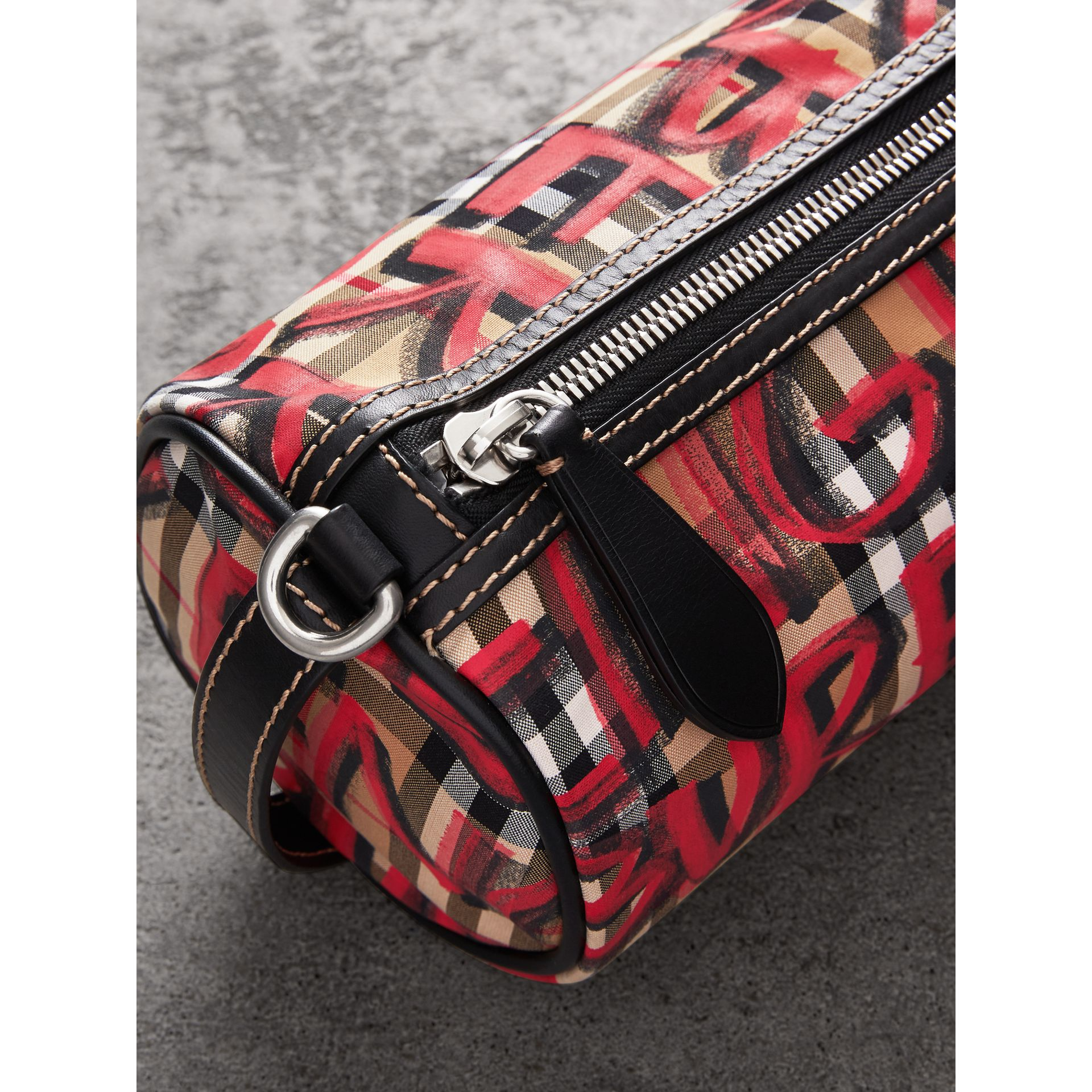 The Small Graffiti Print Vintage Check Barrel Bag in Black - Women | Burberry United Kingdom - gallery image 1