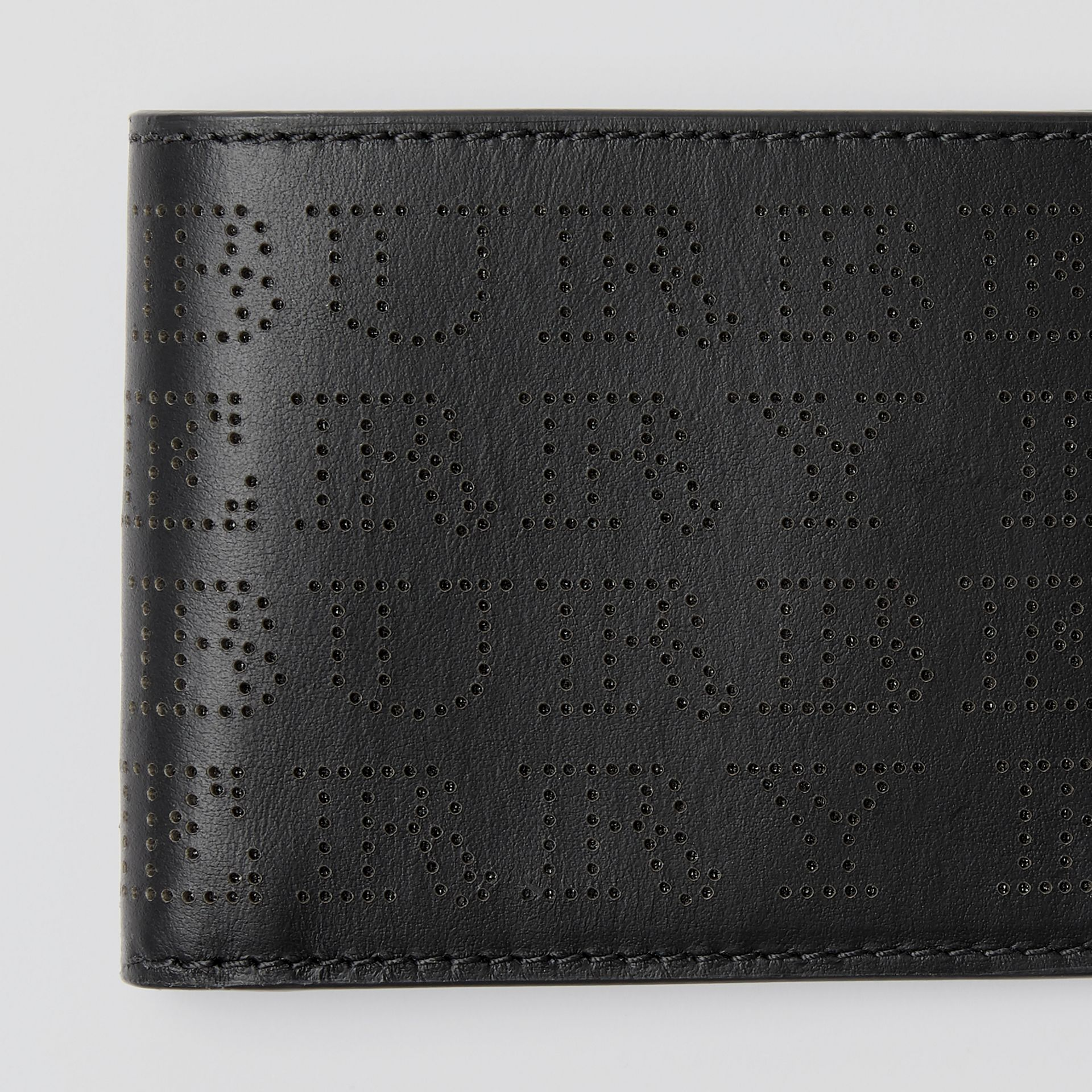 Perforated Logo Leather Bifold Wallet in Black - Men | Burberry - gallery image 1