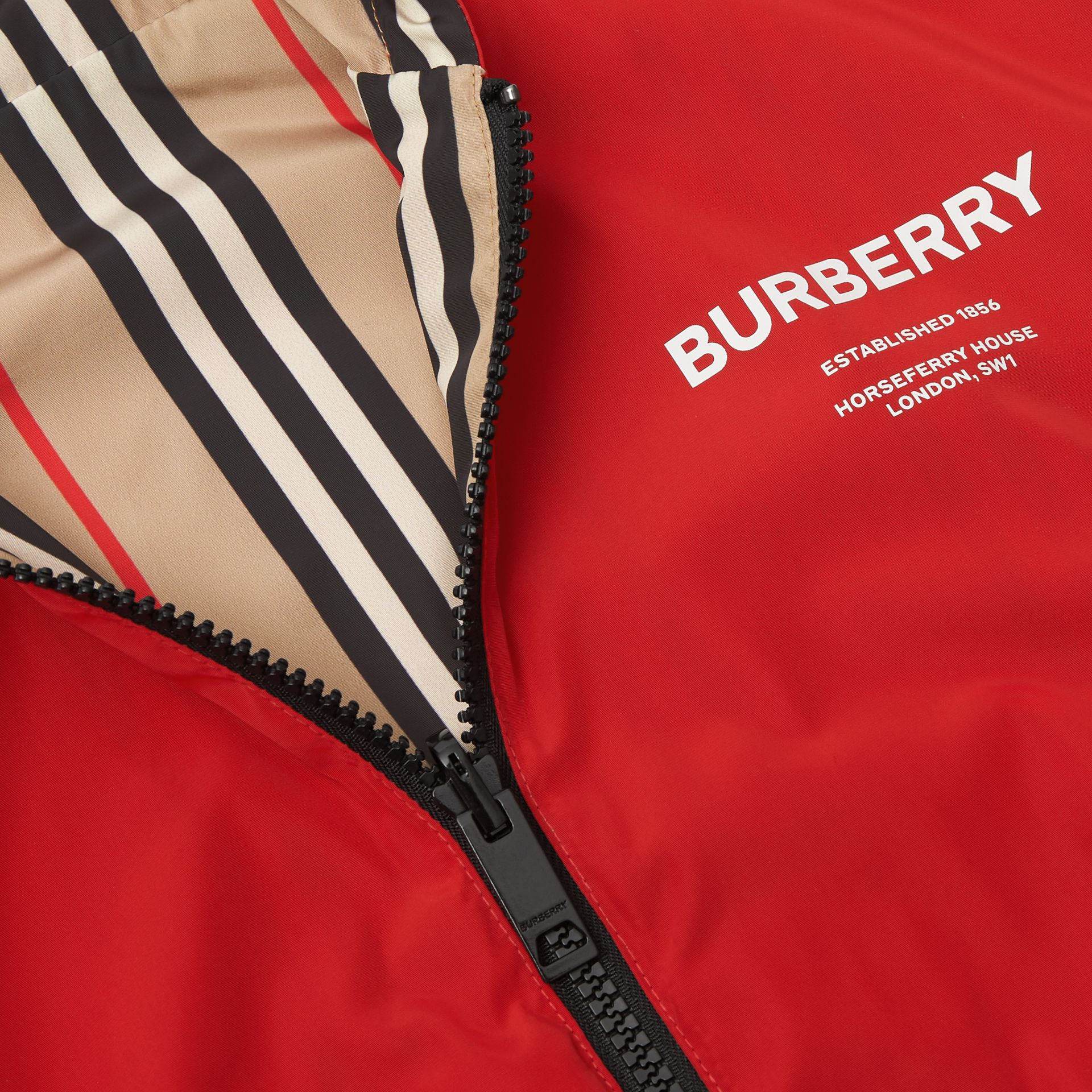 Reversible Icon Stripe Hooded Jacket in Bright Red | Burberry Australia - gallery image 1