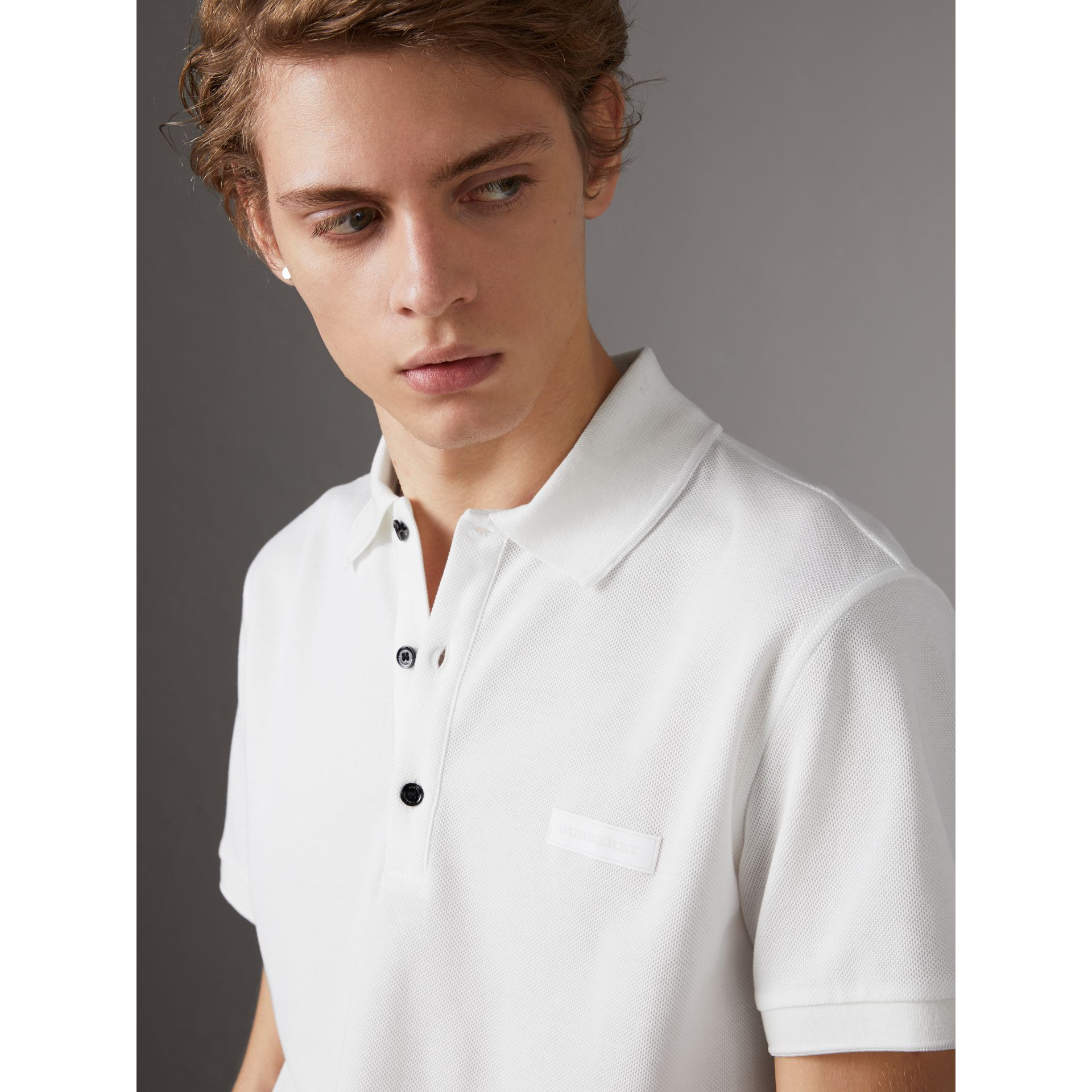 Cotton Piqué Polo Shirt in White - Men | Burberry - gallery image 1