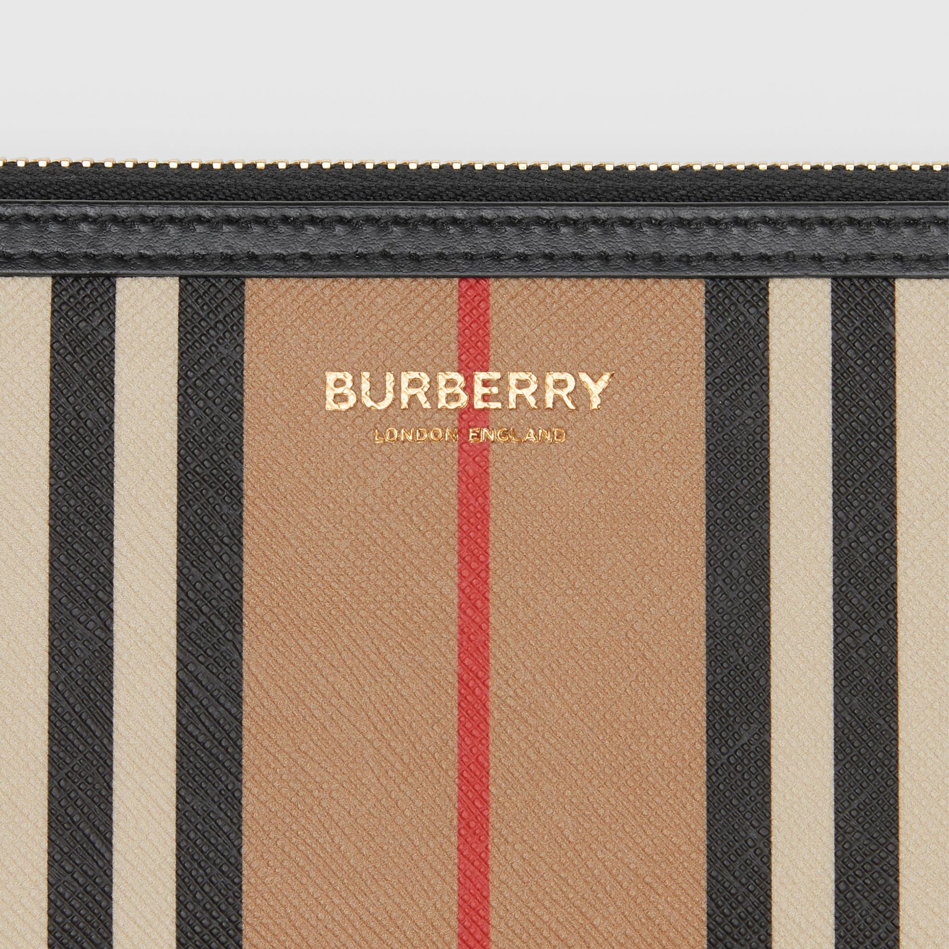 Icon Stripe E-canvas and Leather Ziparound Wallet in Archive Beige - Women | Burberry - gallery image 1