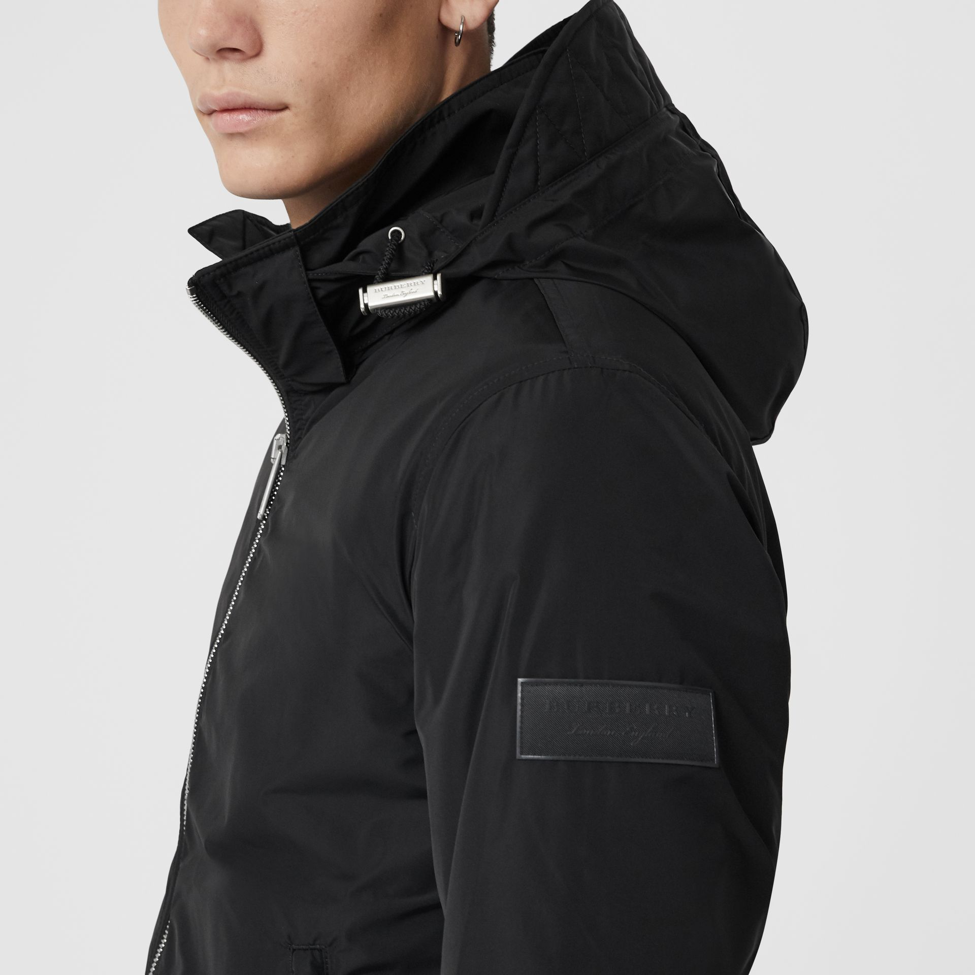 Packaway Hood Showerproof Jacket in Black - Men | Burberry Singapore - gallery image 1