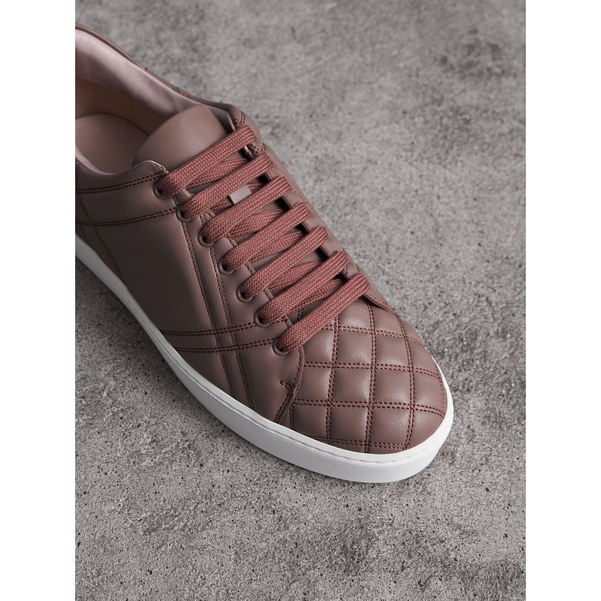 Check-quilted Leather Sneakers in Ivory Pink - Women | Burberry - gallery image 1