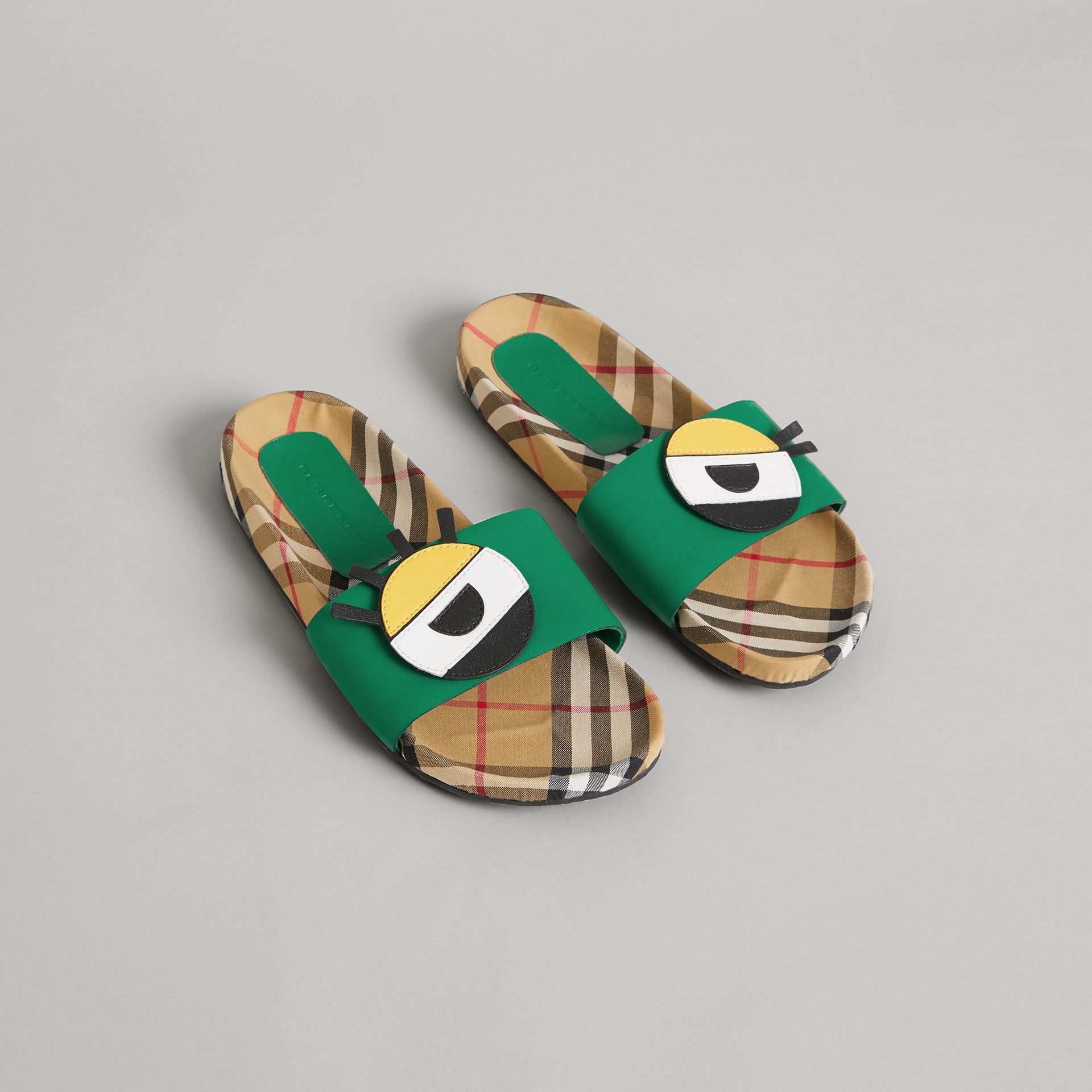 Eye Appliqué Vintage Check and Leather Slides in Bright Pigment Green | Burberry - gallery image 0